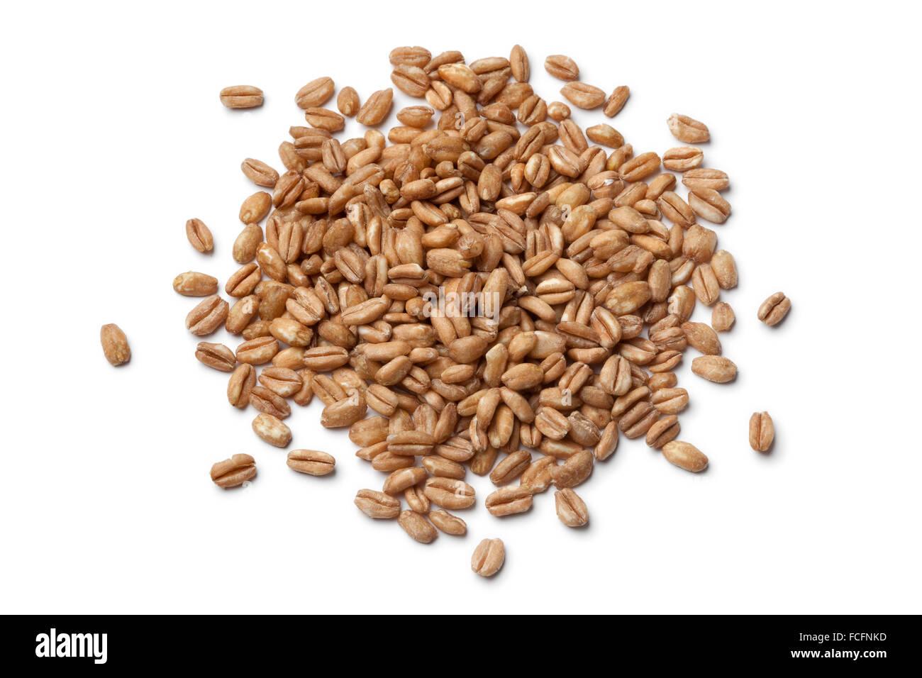 Heap of raw Farro grains on white background Stock Photo