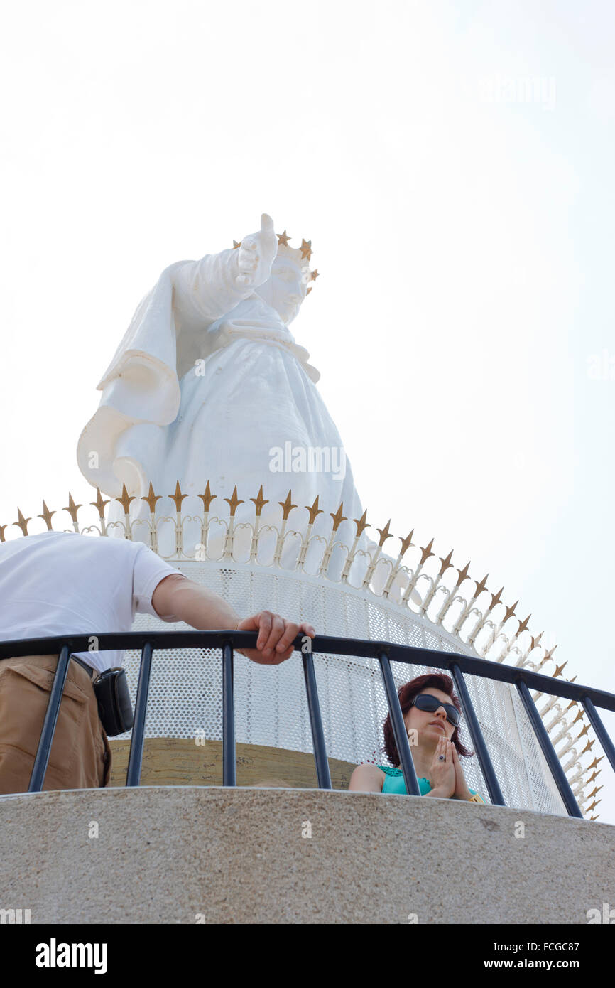 Women praying under Our Lady of Lebanon statue, Jounieh, Beirut, Lebanon - Stock Image
