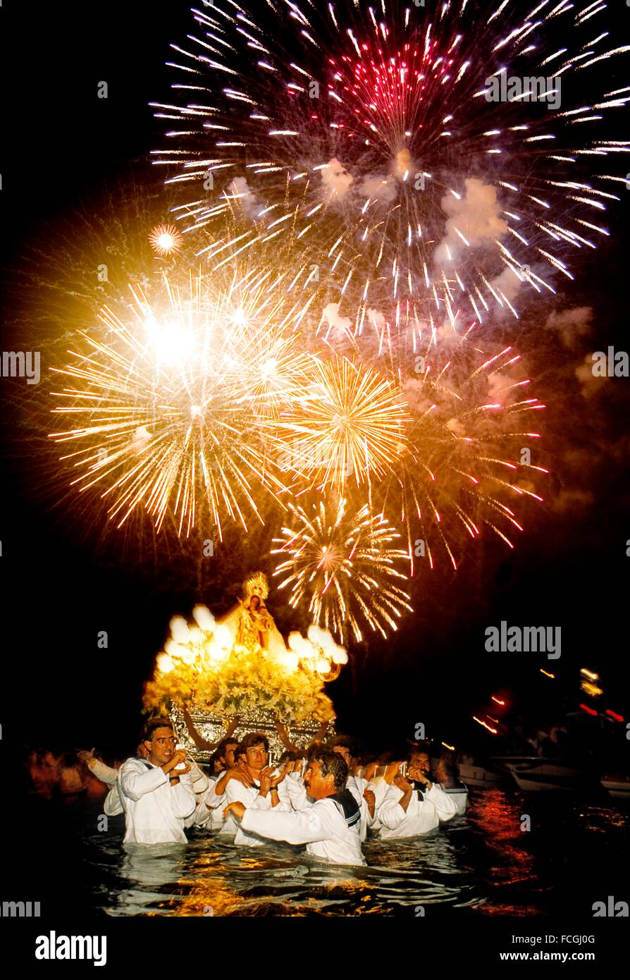 Fireworks seafaring procession Virgen del Carmen, Fuengirola, Malaga, Andalusia, Spain - Stock Image