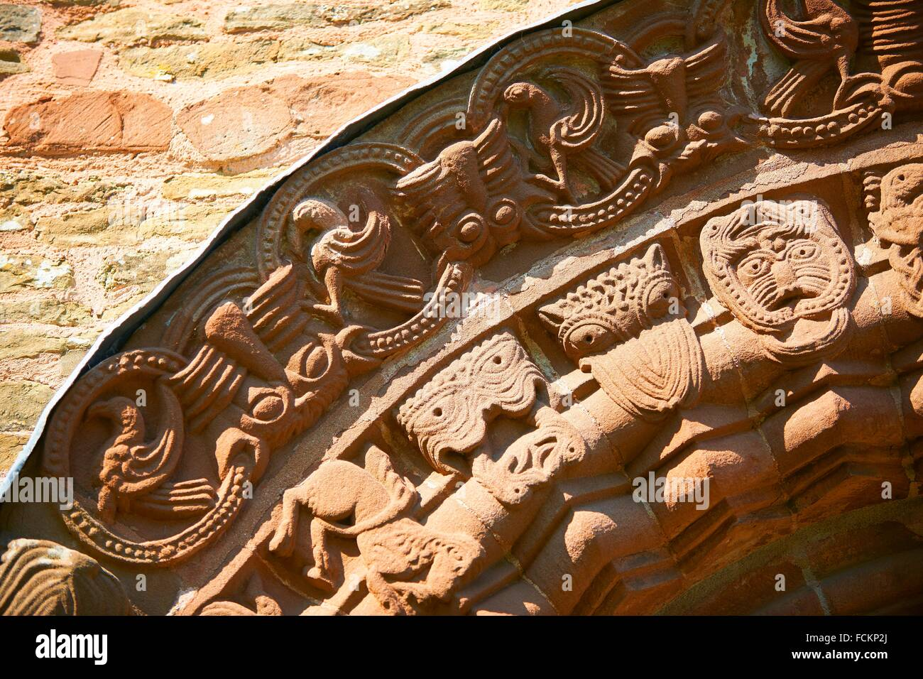 Norman Romanesque relief sculptures of dragons and mythical creatures depicting the struggle between good and evil, - Stock Image