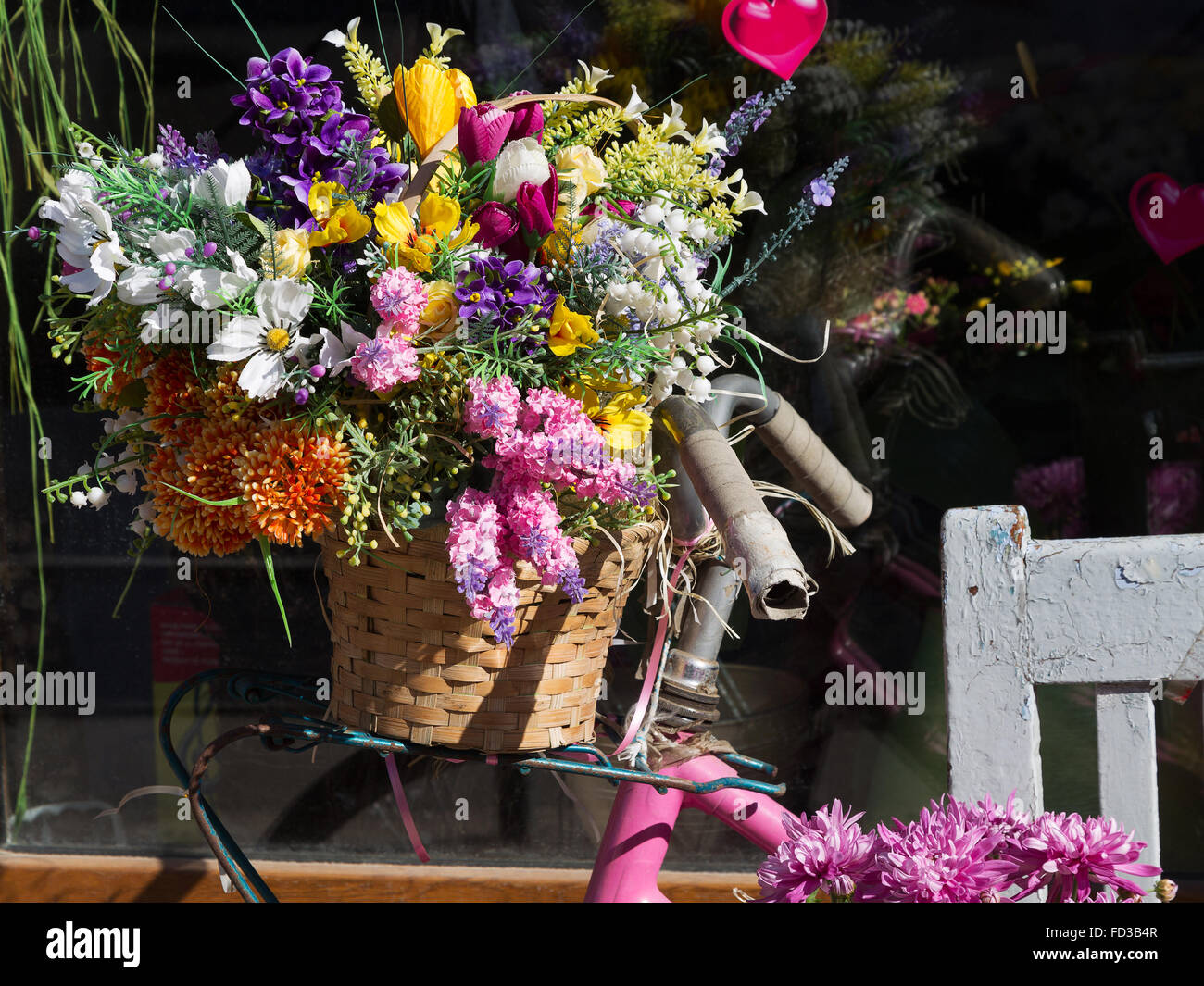 Bright Spring Flowers In A Wooden Box Iron Bucket In The Background