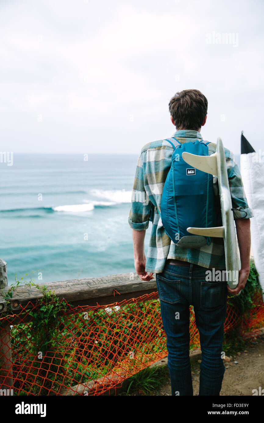 A young man explores Big Sur, California. - Stock Image