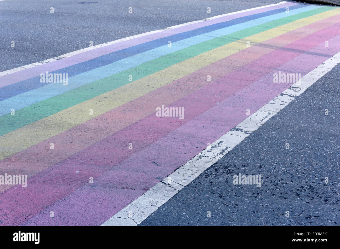 Rainbow crosswalk symbolic of gay pride in the downtown West End of Vancouver, BC, Canada Stock Photo