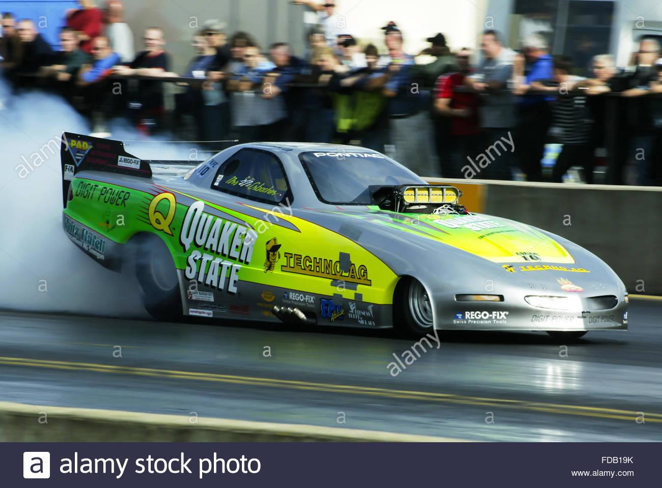 Drag racing at Santa pod in the UK . Funny car warming its tyres ...