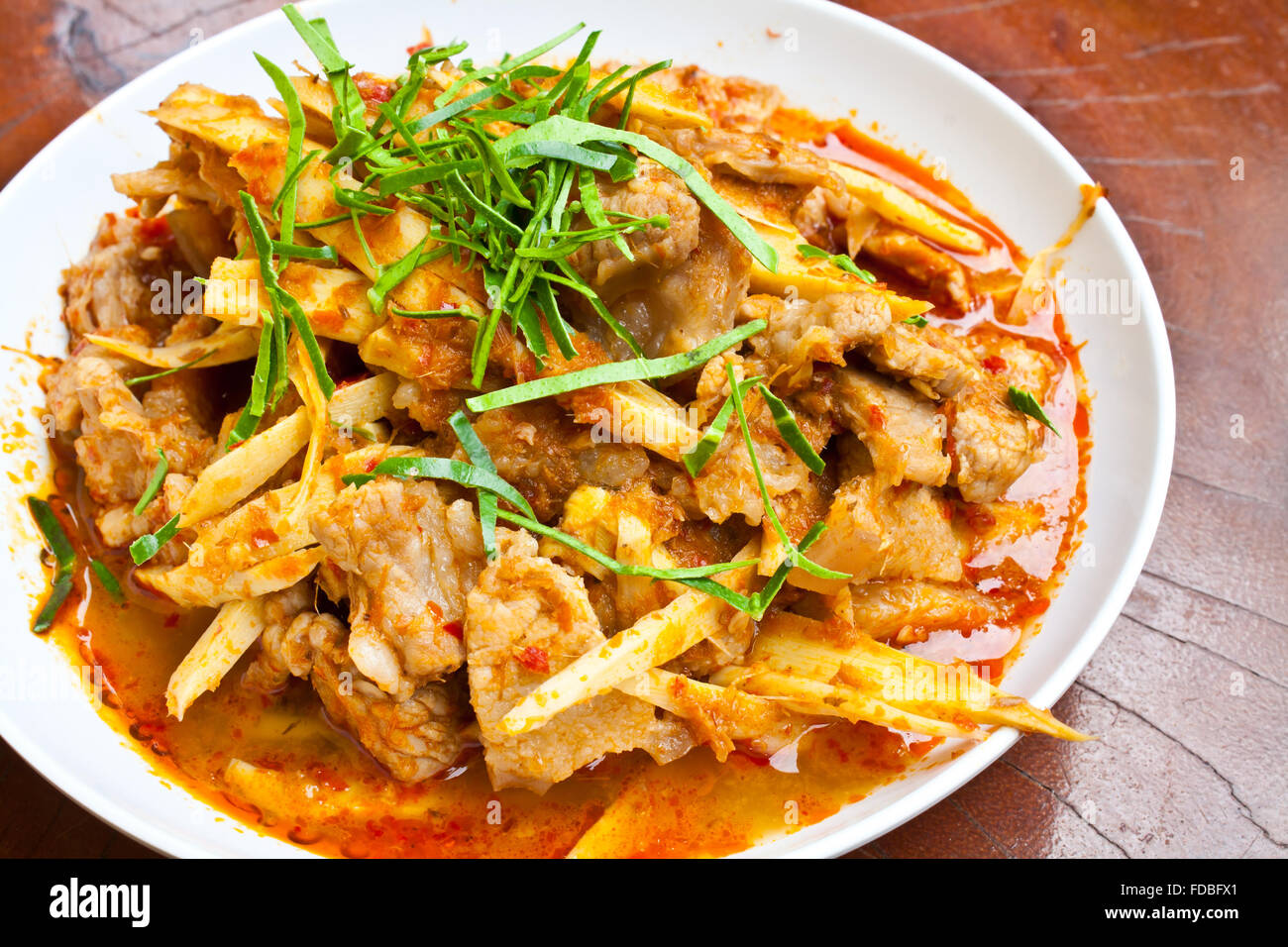 Stir Fried Pork Belly with Red Curry Paste and Bamboo Shoots - Stock Image