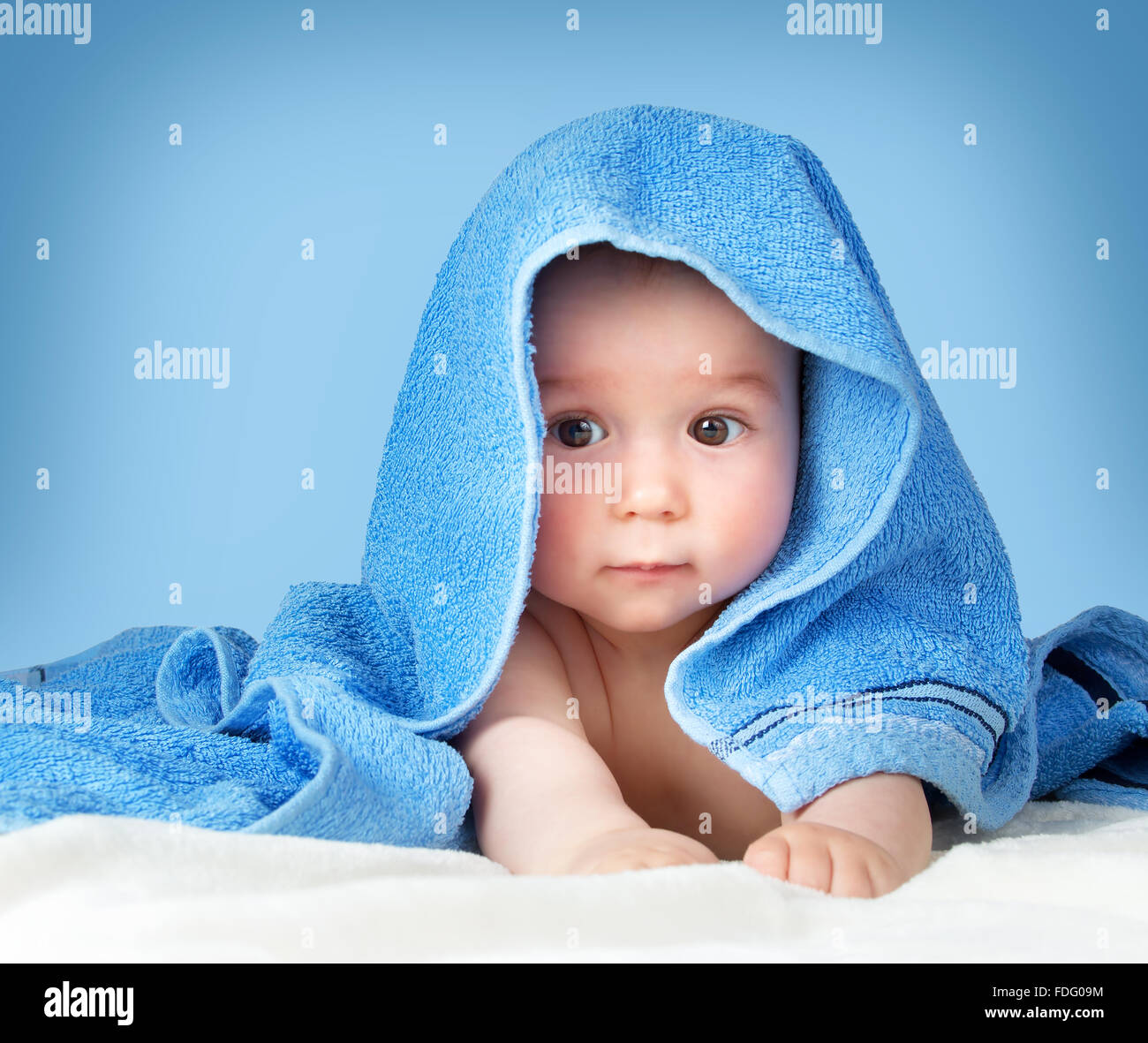 Cute baby in a towel - Stock Image