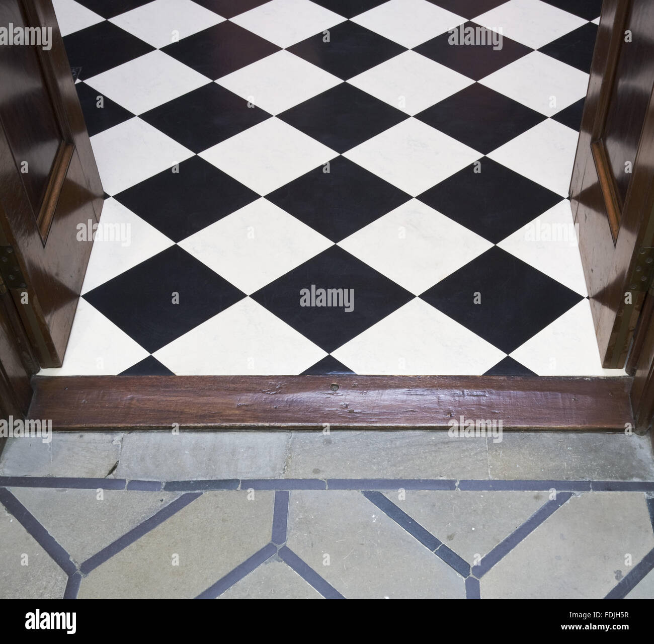 The meeting of the floors of the Hall with black and white linoleum
