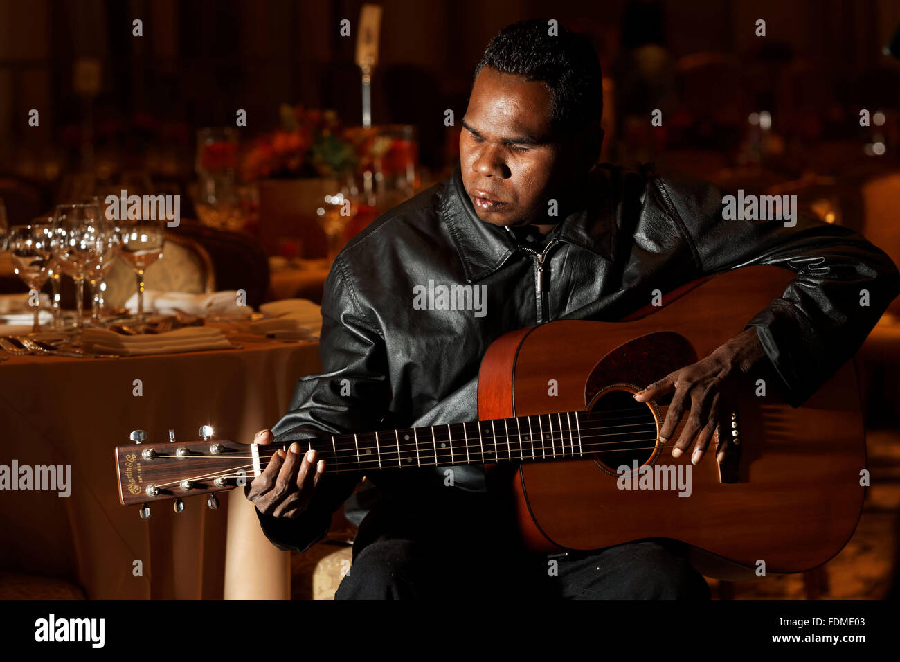 Australian Aboriginal blind singer and songwriter Geoffrey Gurrumul Yunupingu warms up in an empty room at the Waldorf Stock Photo
