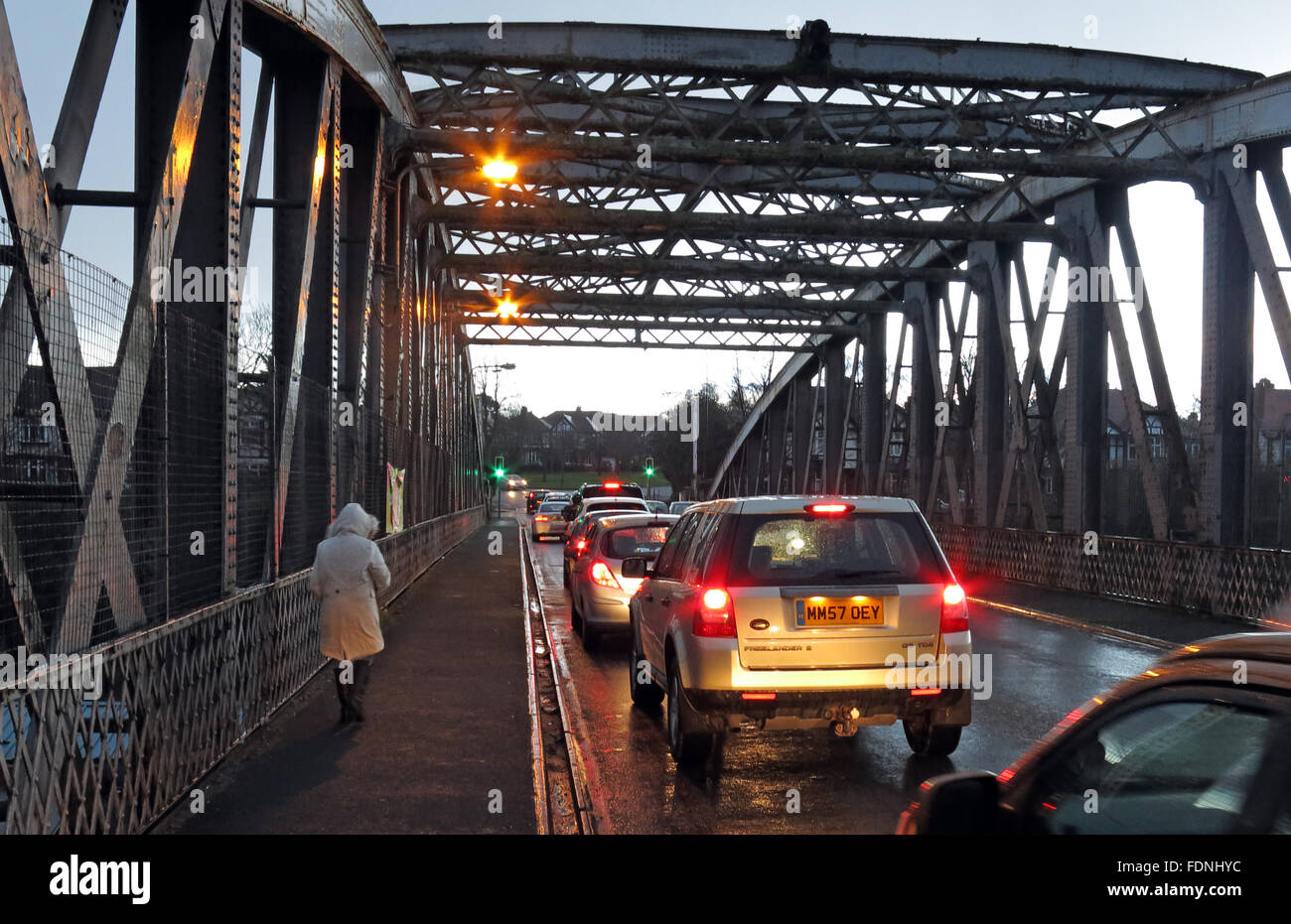 rd,rain,wet,delay,delays,swing,crossing,Warrington,Cheshire,England,UK,United,Kingdom,at,dusk,more,congestion,steel,iron,person,woman,walk,walking,walker,with,car,cars,rear,lights,brake,Latchford,Knutsford Road,Manchester Ship Canal,Road Bridge,with walker,Brake Light,Brake Lights,GoTonySmith,@HotpixUK,night,delay,delays,delayed.late,later,WBC,Buy Pictures of,Buy Images Of,Images of,Stock Images