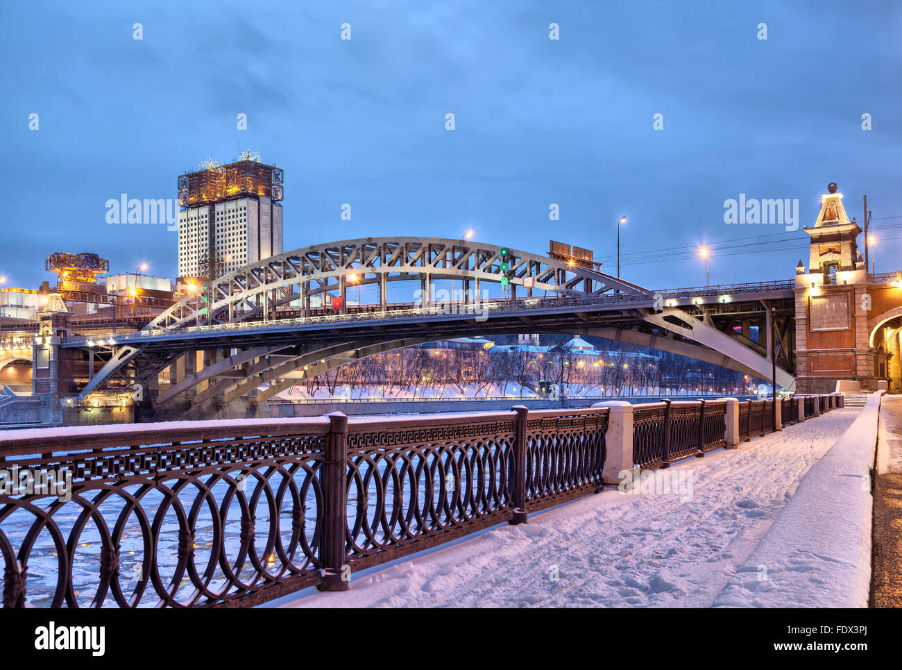 Embankment of Moscow river near Andreevsky railroad bridge and building of Science Academy in the evening, Moscow, - Stock Image