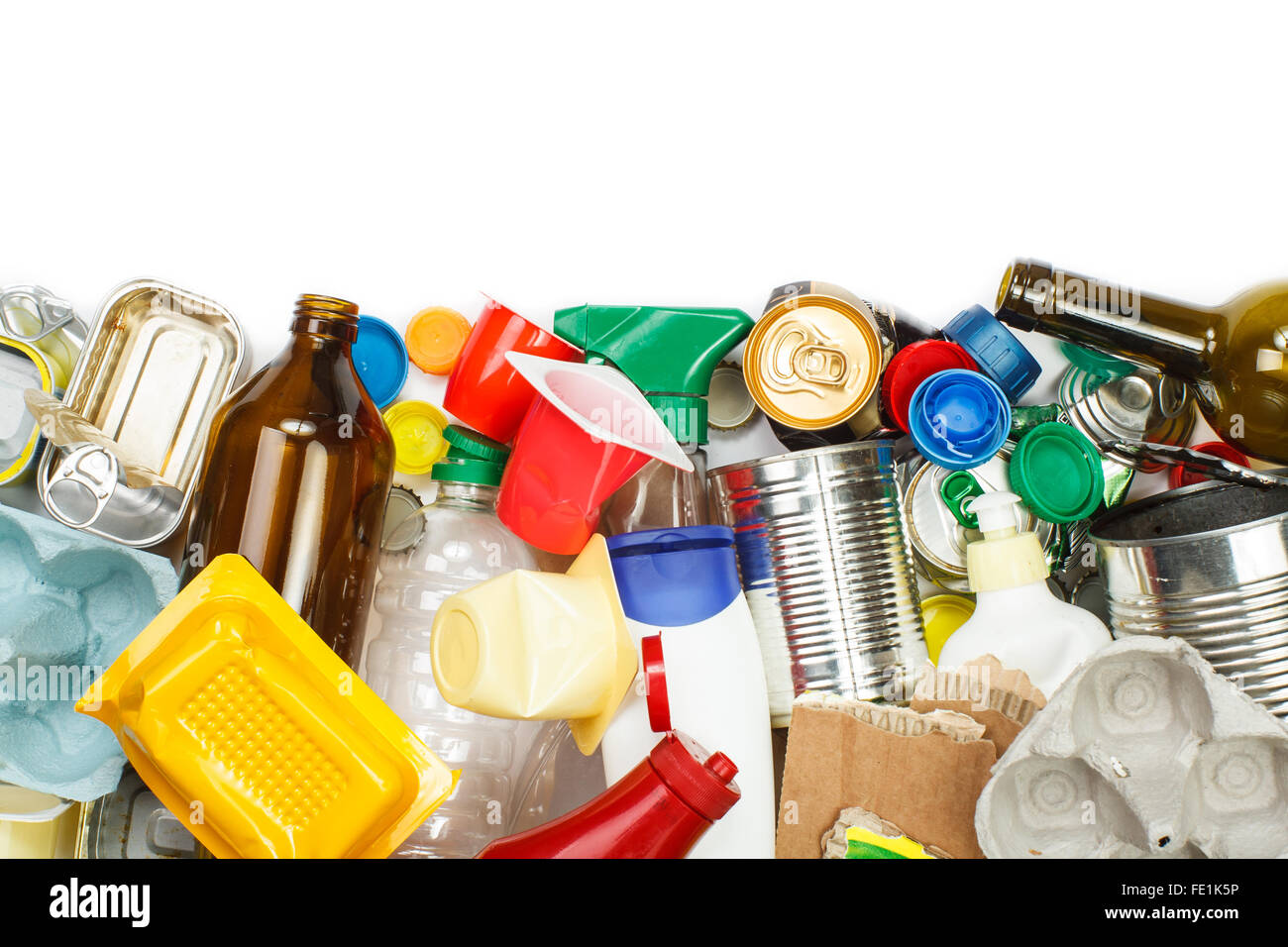 A selection of garbage for recycling. Segregated metal, plastic, paper and glass. Empty space for text - Stock Image