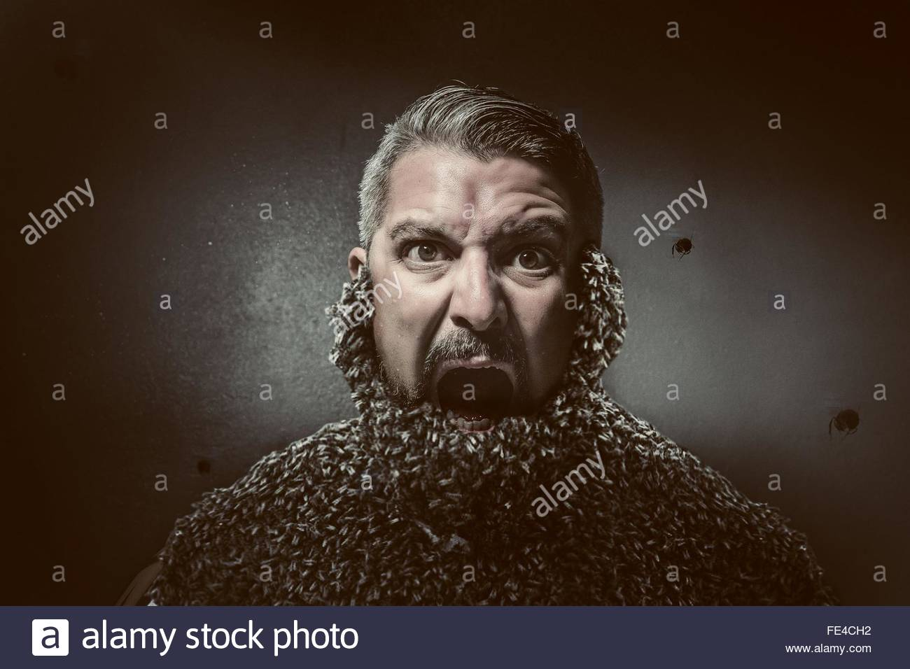 Bizarre Shot Of Man With Swarm Of Bees Covering His Face - Stock Image