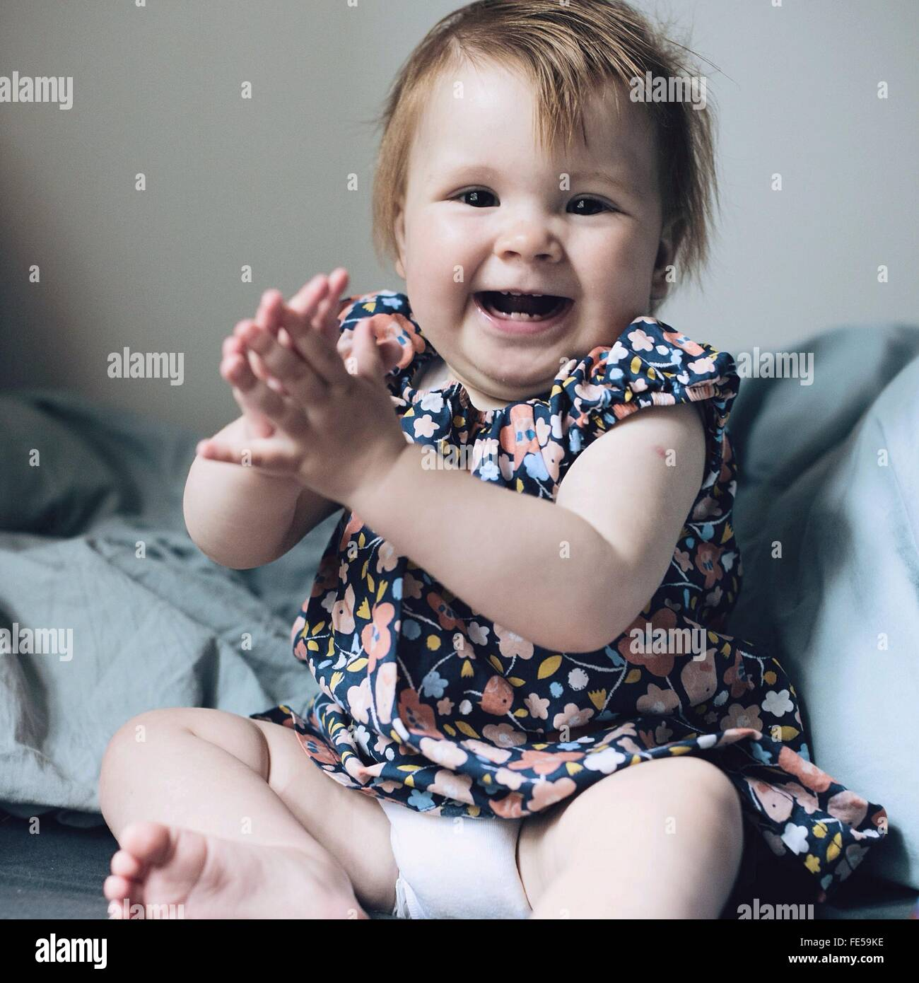 Baby Girl Laughing - Stock Image