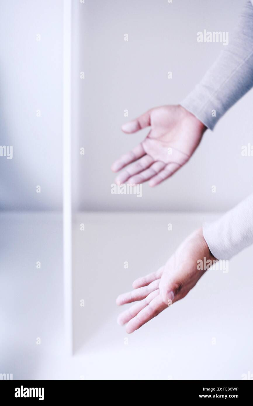 Man With Her Hands Out - Stock Image