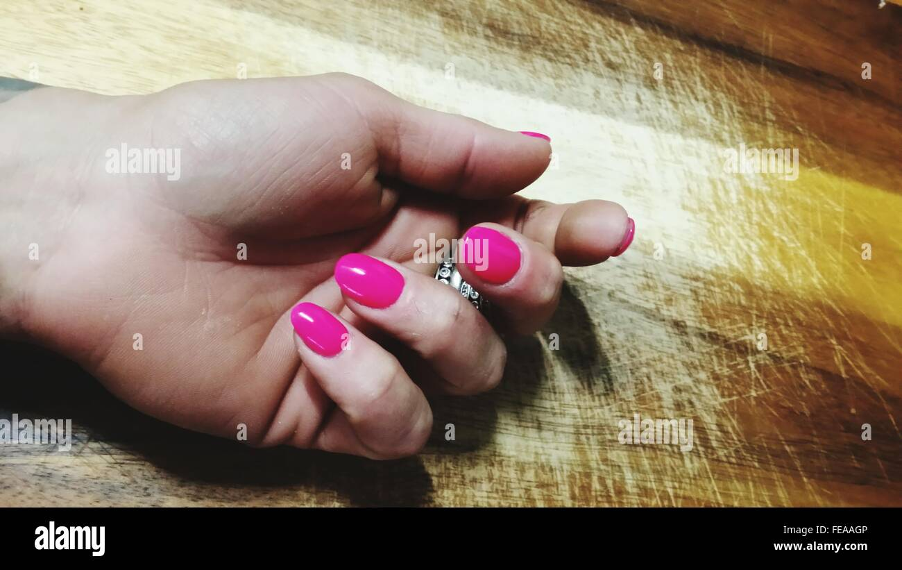 Female Hand With Pink Nail Polish - Stock Image