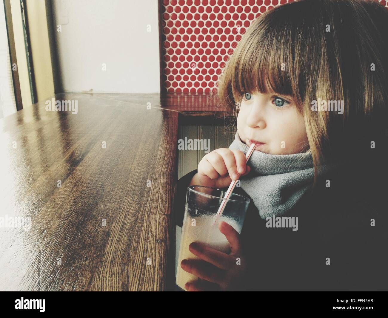 Girl Drinking Juice - Stock Image