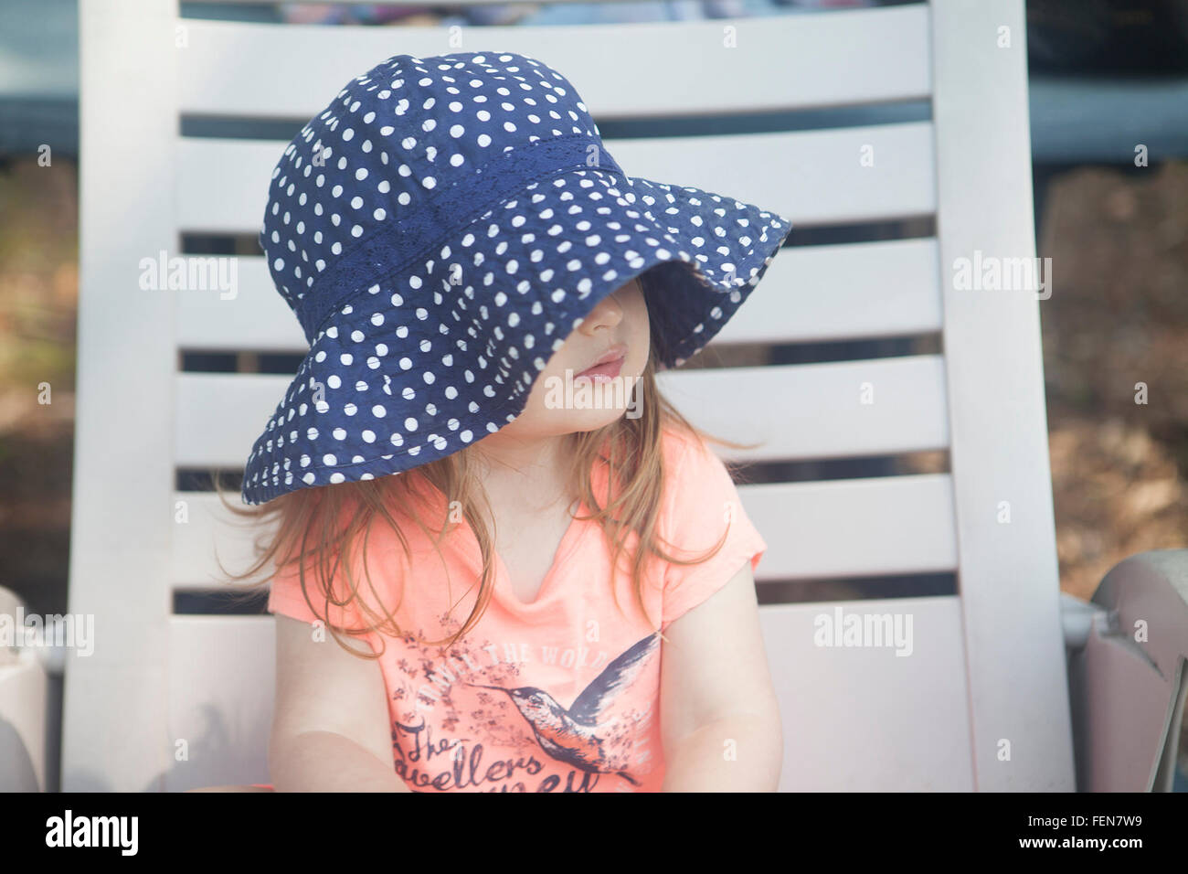 Girl Sitting On Deckchair - Stock Image