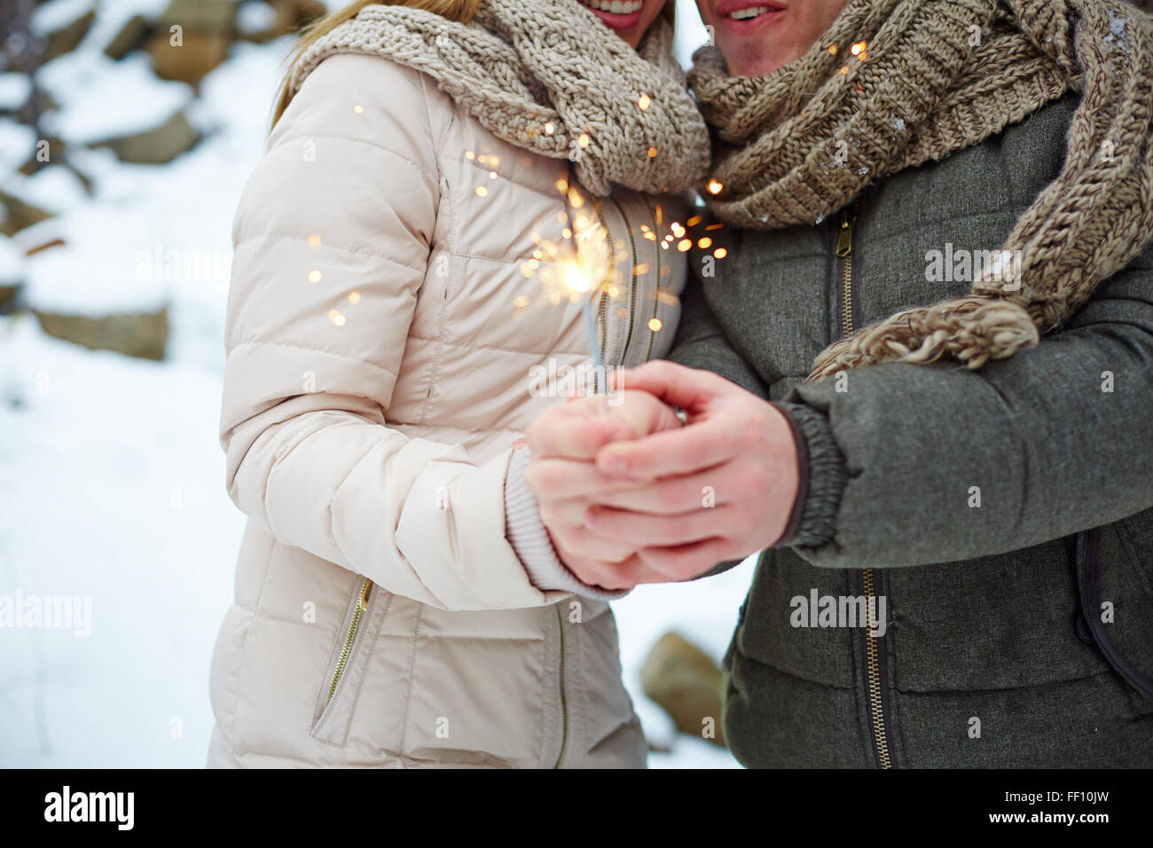 Young dates burning Bengal light on Valentine day - Stock Image