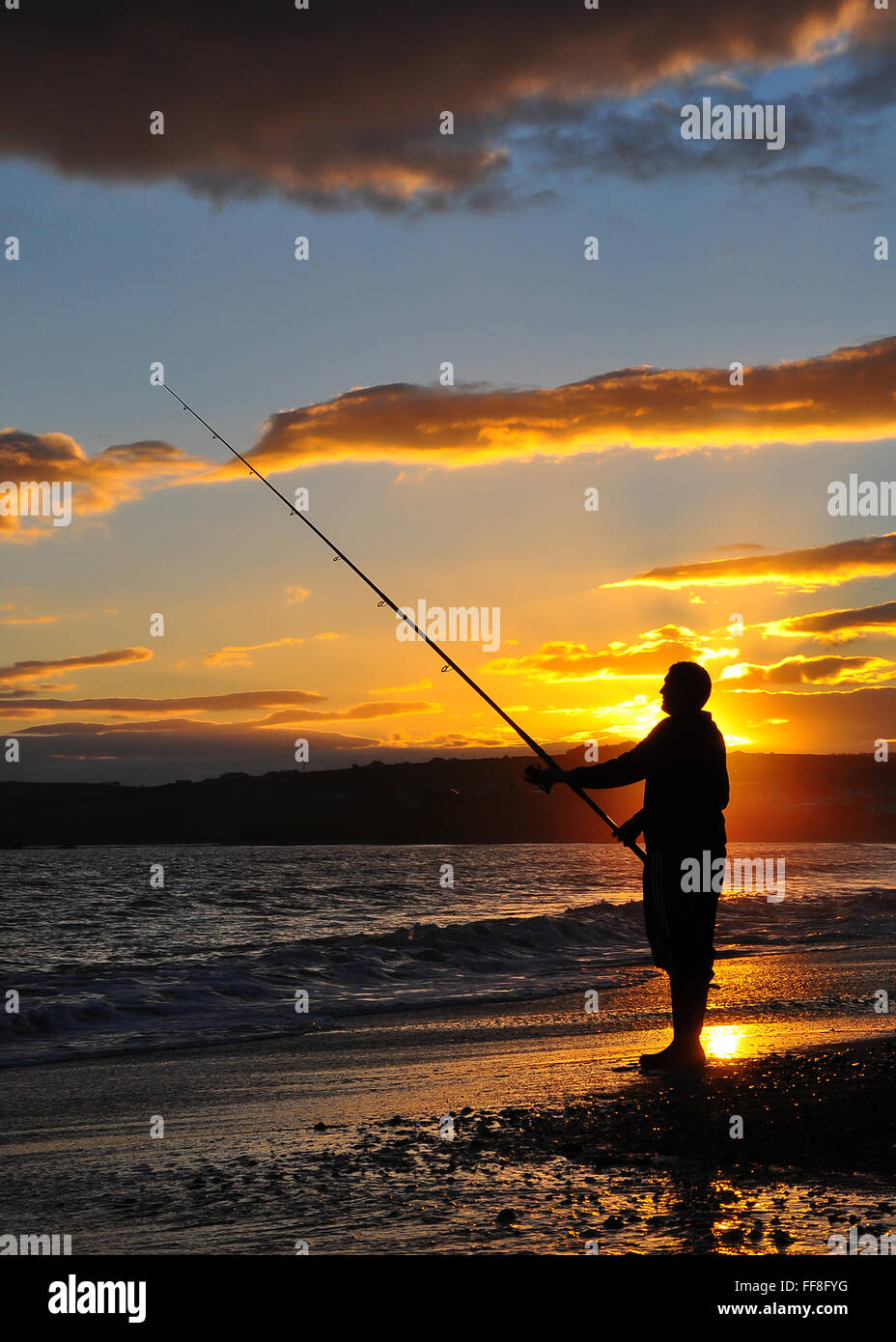 ocean-fisherman-waits-for-a-catch-as-the