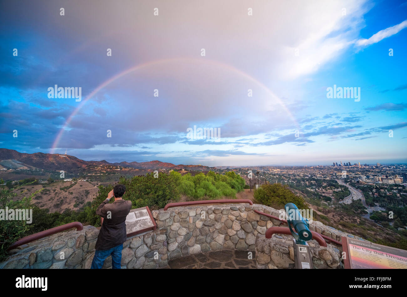 Rainbow over Hollywood Sign and Los Angeles. Scenic view from Hollywood Bowl Overlook. With rainbow and rain storm Stock Photo