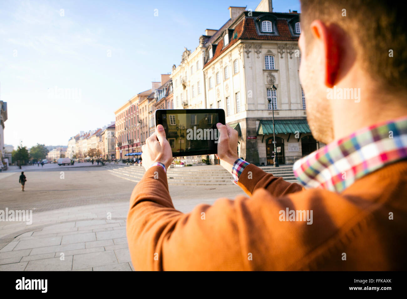 Man on a city break taking a picture with smart phone Stock Photo