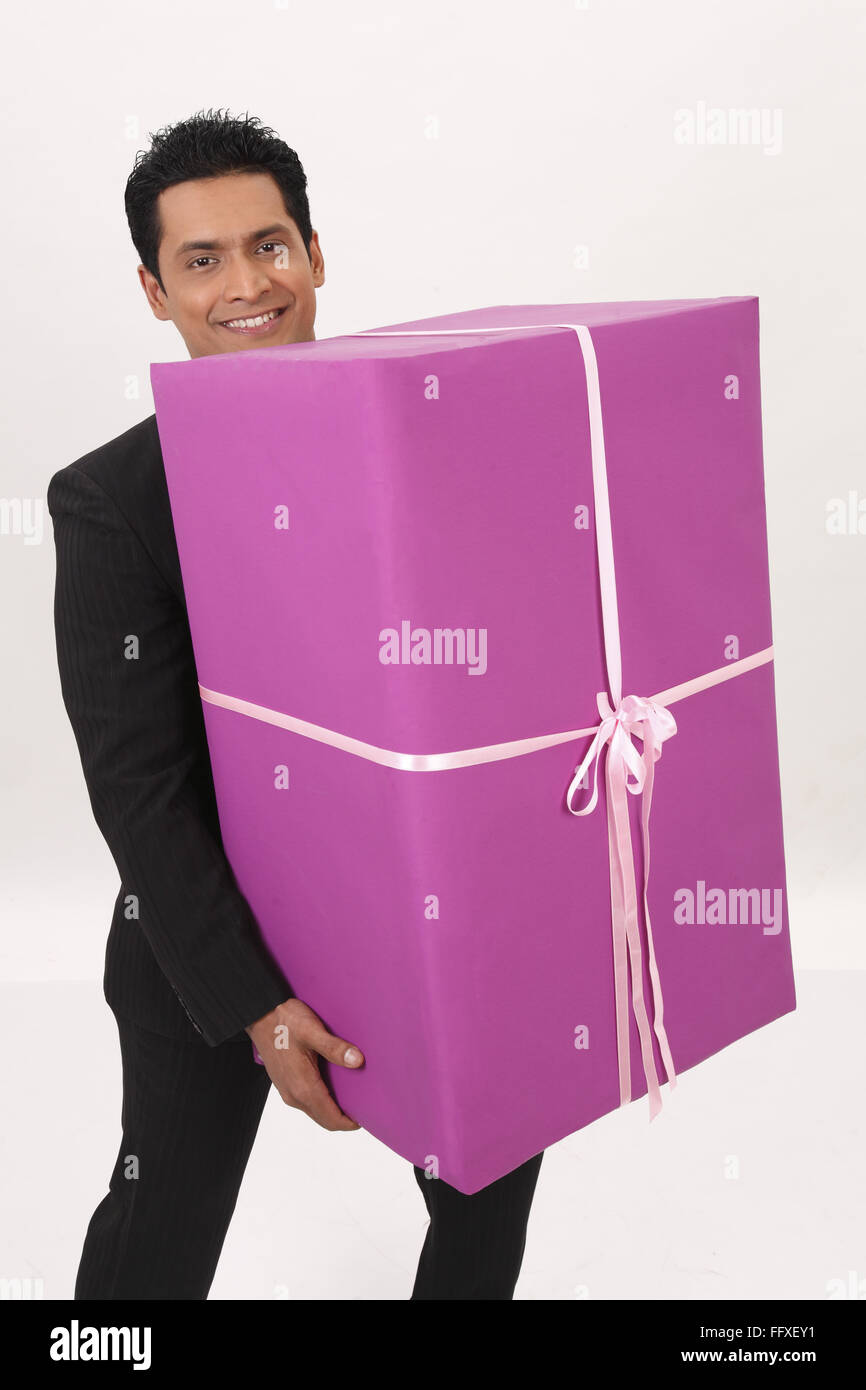 businessman holding big gift box in both hands mr 703t stock photo