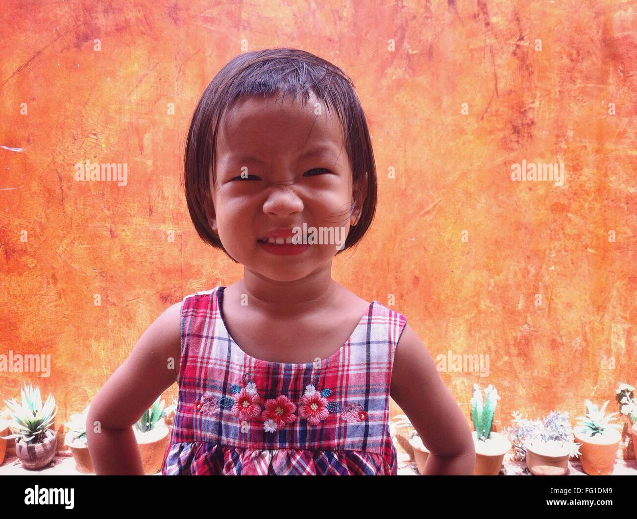 Portrait Of Cute Girl Making Face Outdoors - Stock Image