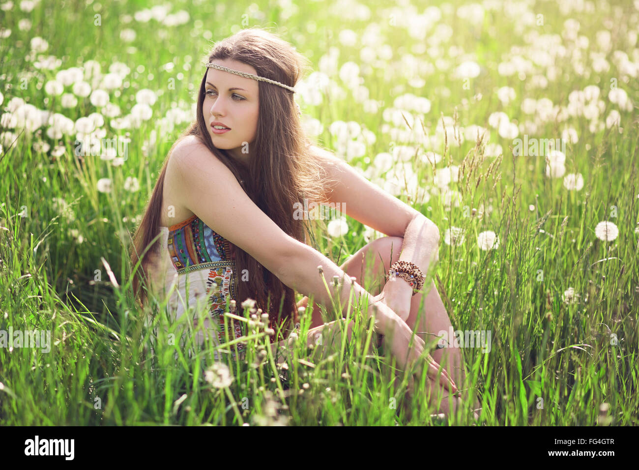 Beautiful woman in a flowered meadow . Nature harmony and freedom - Stock Image
