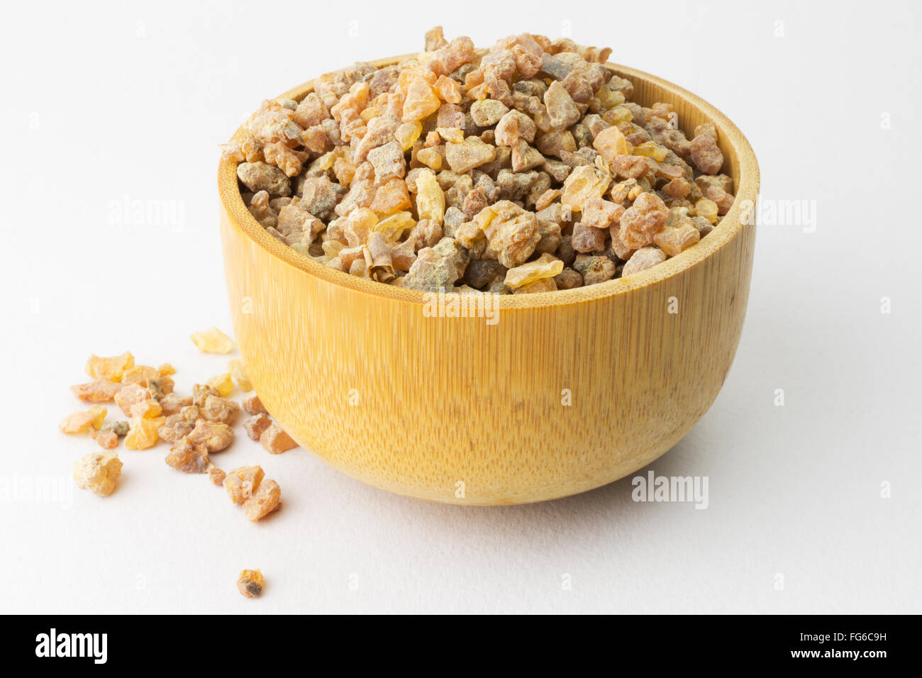 Myrrh in Wooden Bowl Stock Photo