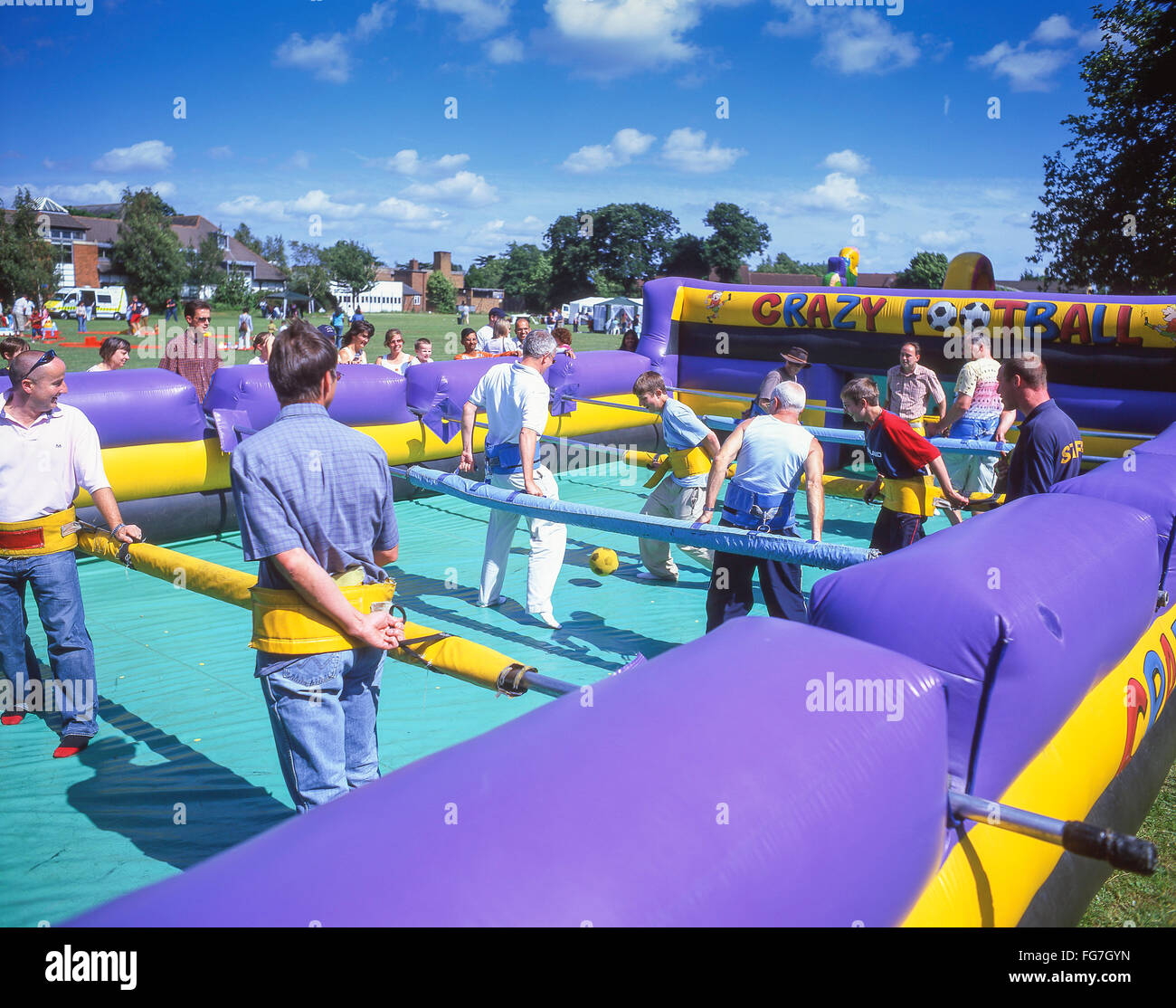 'Crazy football' inflatable Human Table Football game at summer fete, Bracknell, Berkshire, England, United - Stock Image