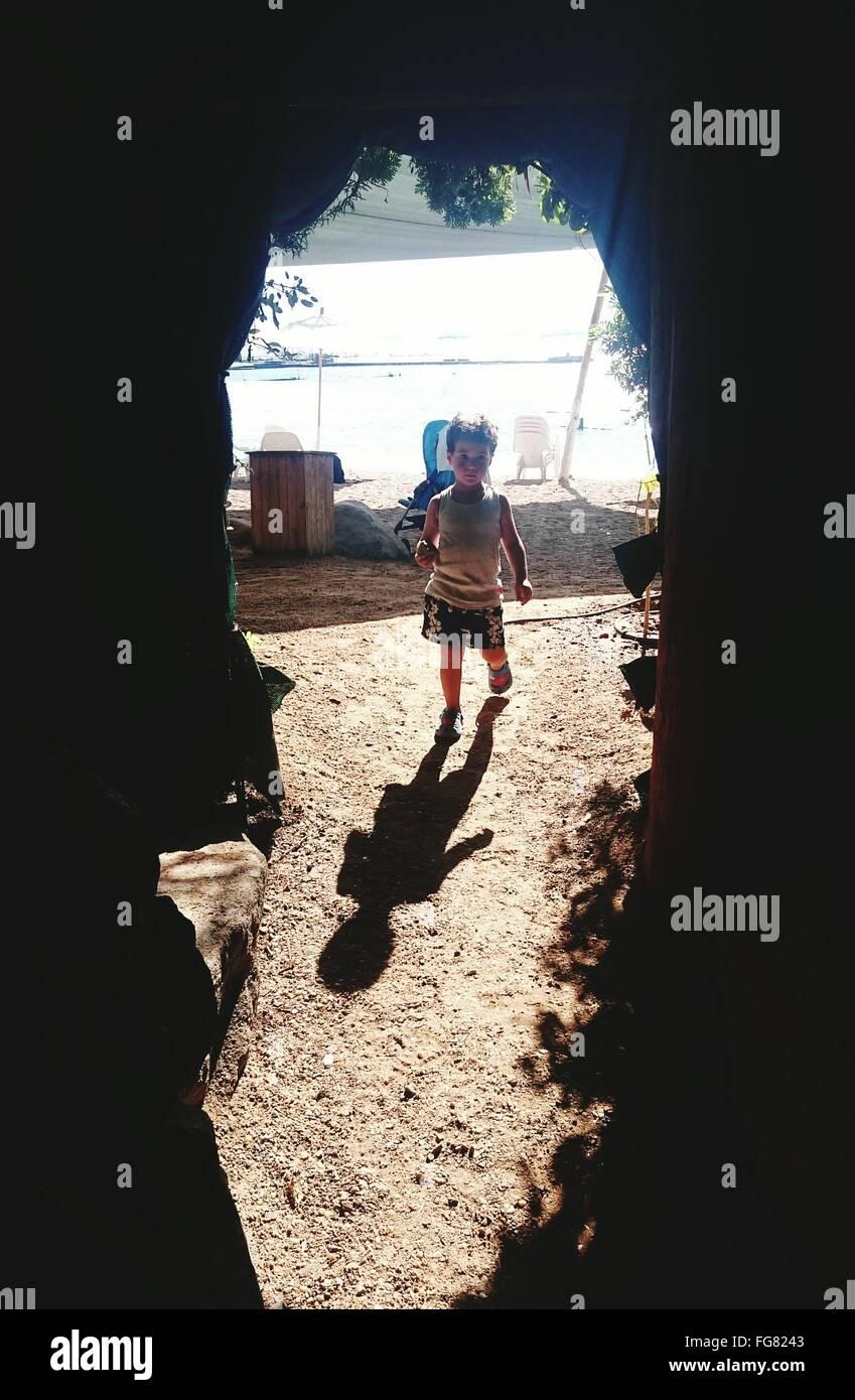 Boy Walking In Field - Stock Image