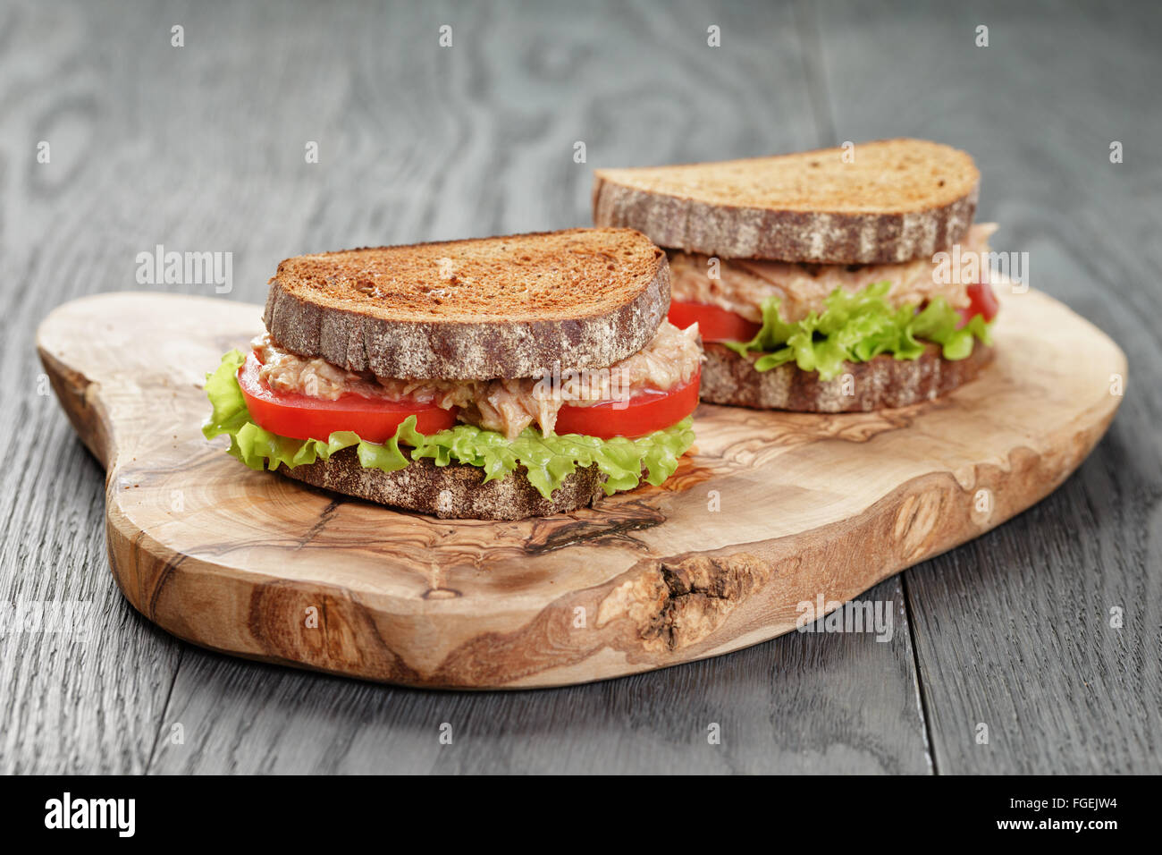 rye bread sandwich with tuna and vegetables - Stock Image