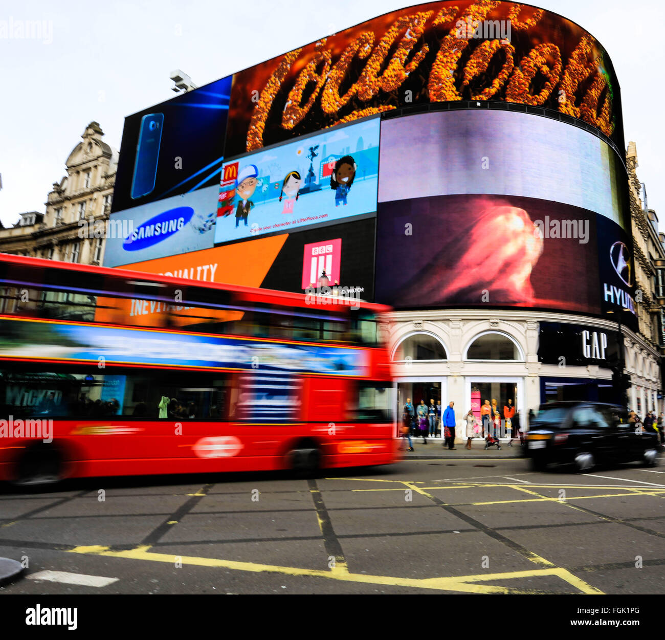 London Bus and Taxi passing Picadilly Circus London - Stock Image