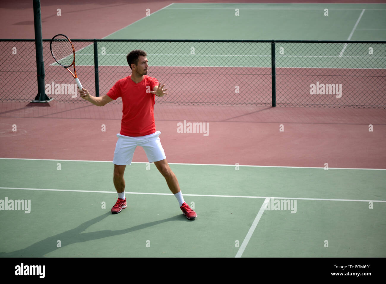 Male tennis player practice in tennis court in Dubai. - Stock Image