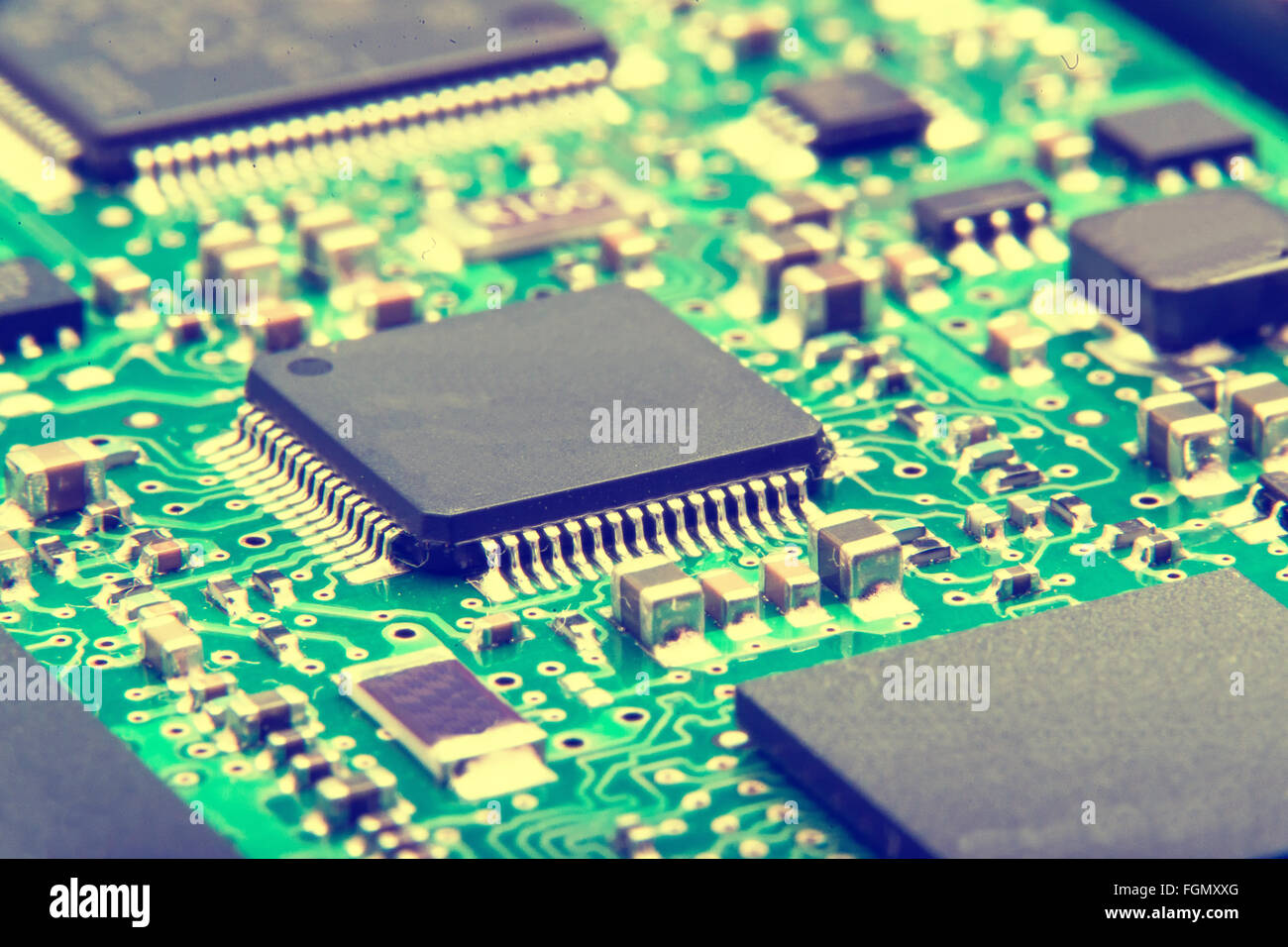 Electronic circuit board close up. Green PCB - Stock Image