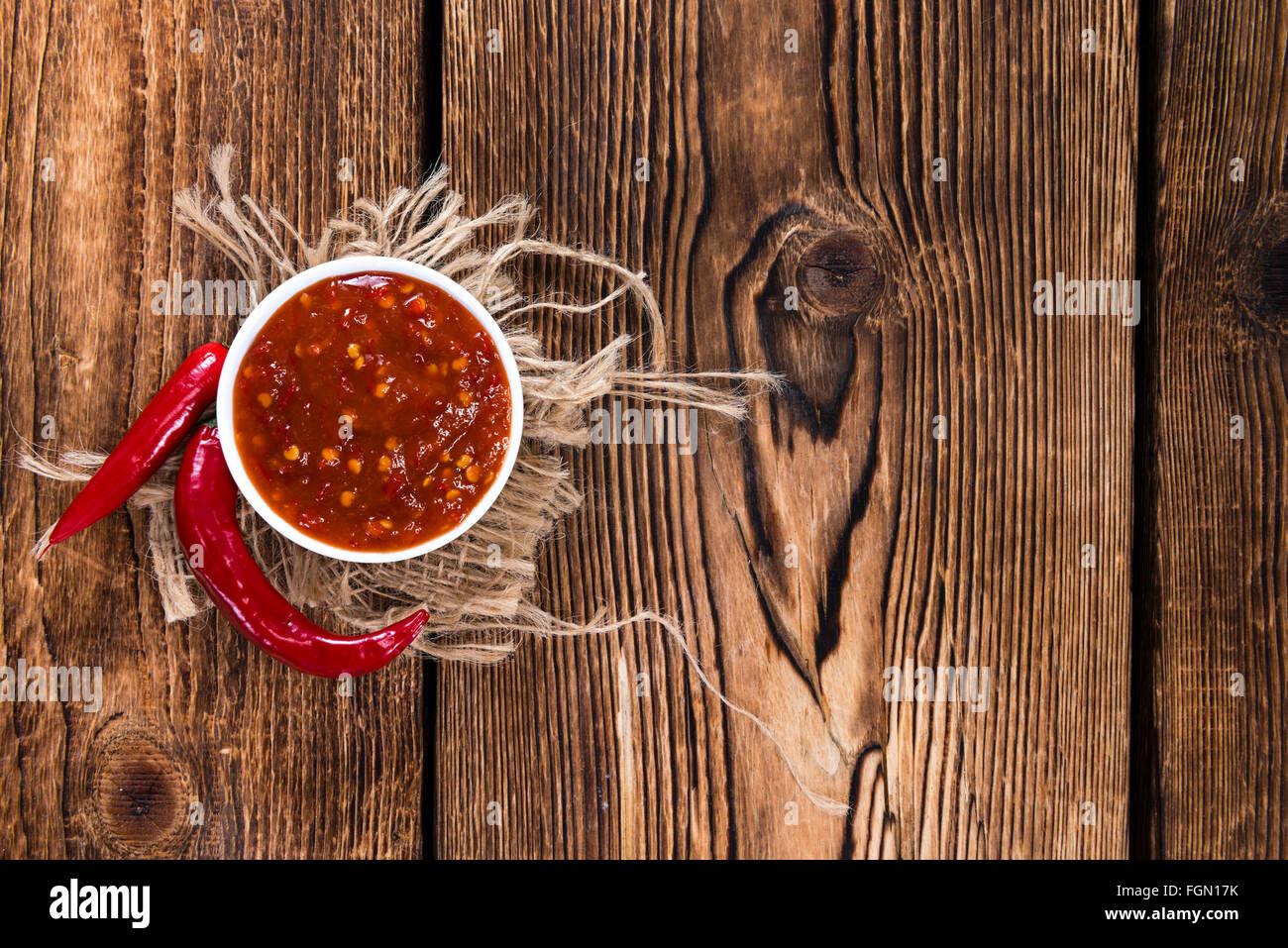 Sambal Oelek (fresh made) on wooden background Stock Photo