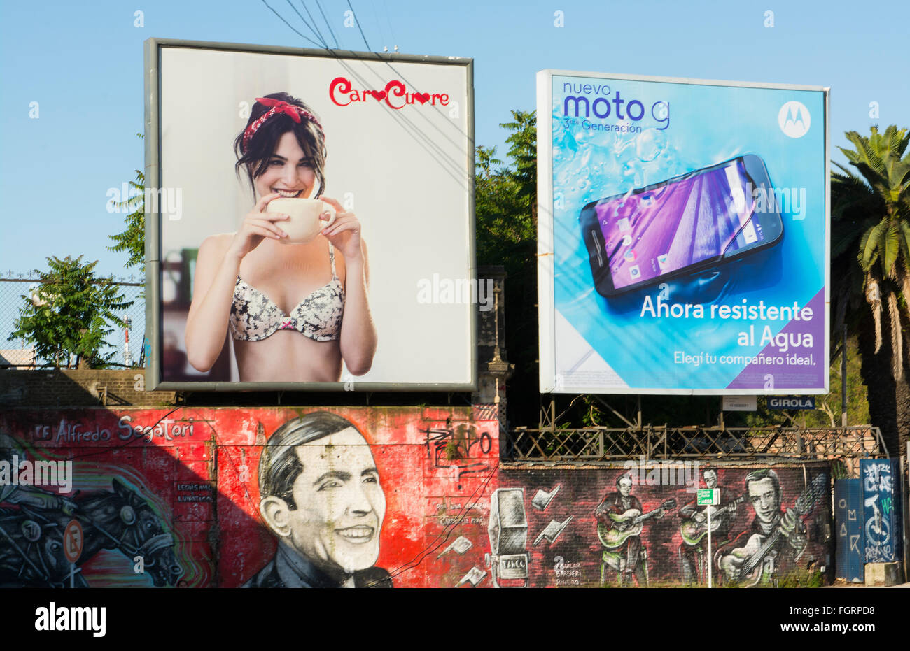 Buenos Aires Argentina billboards and artwork on wall downtown city centre - Stock Image