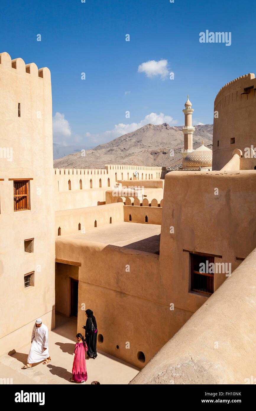 Omani Tourists At The Nizwa Fort, Nizwa, Ad Dakhiliyah Region, Oman - Stock Image