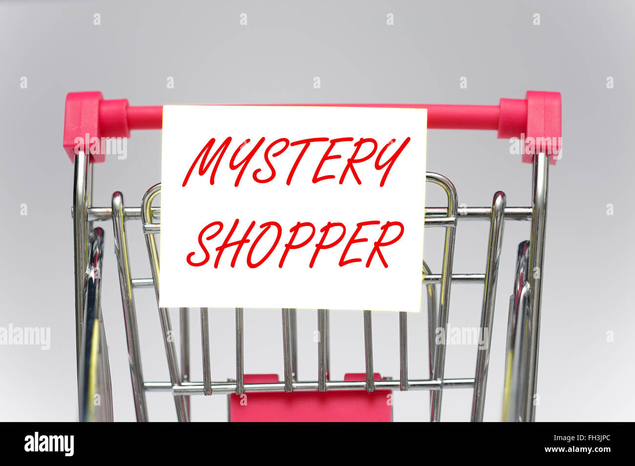 Mystery shopper on a supermarket shopping trolley - Stock Image