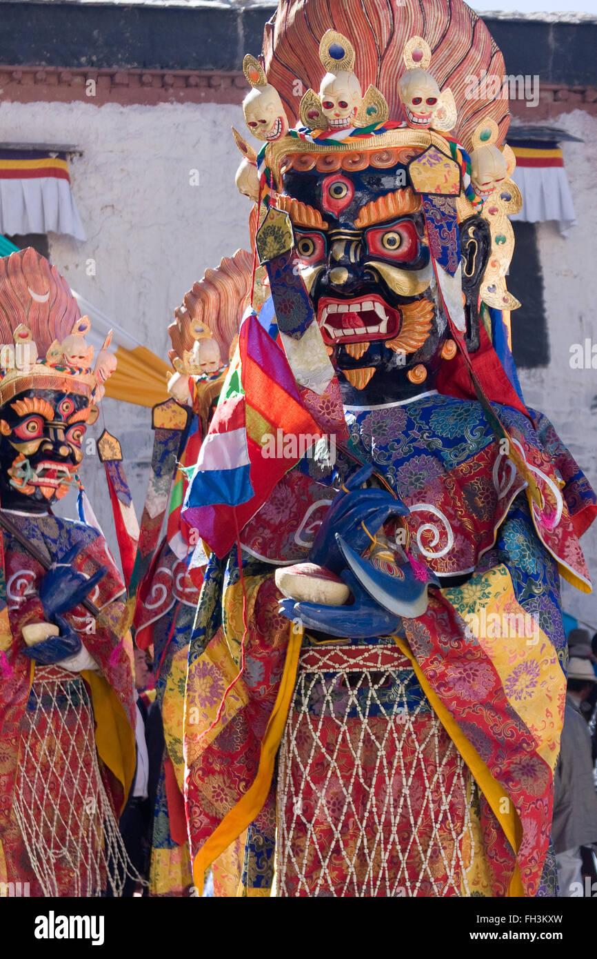 Lama performing the mask dance during Saga Dawa festival Gyantse Shigatse Tibet - Stock Image