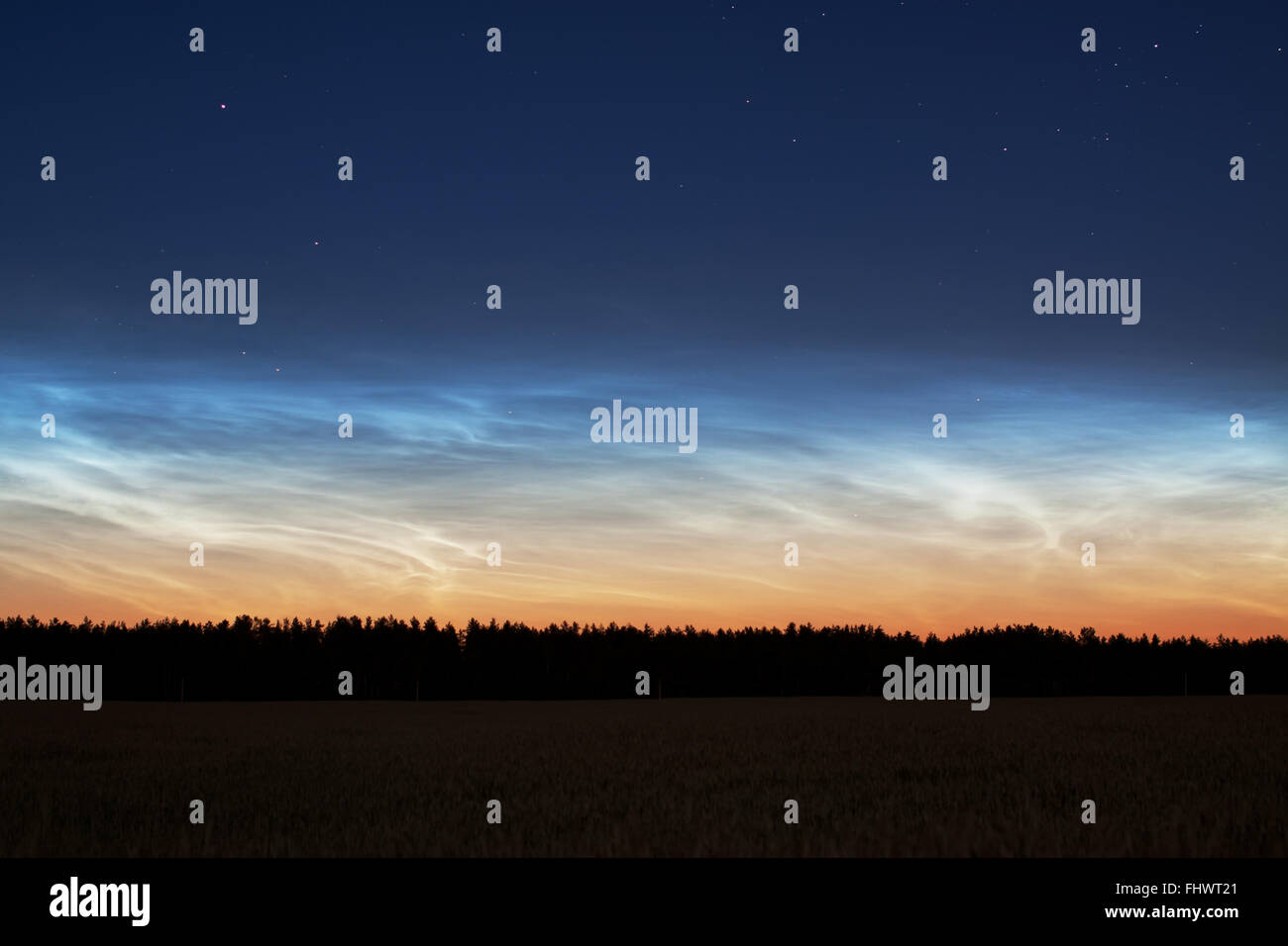 Rare sky phenomenon noctilucent clouds night rural landscape photograph - Stock Image