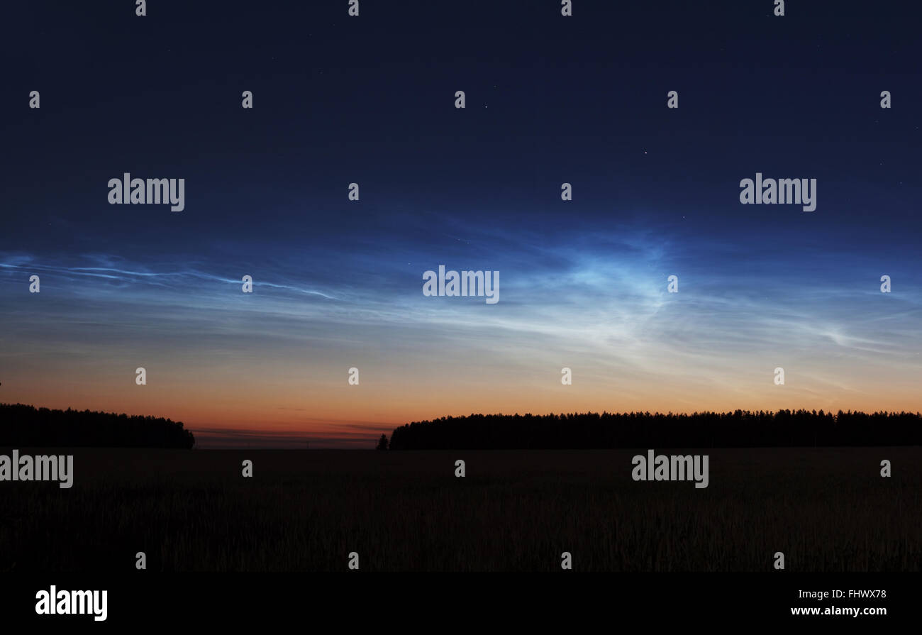 Noctilucent clouds sunset night landscape with stars - Stock Image