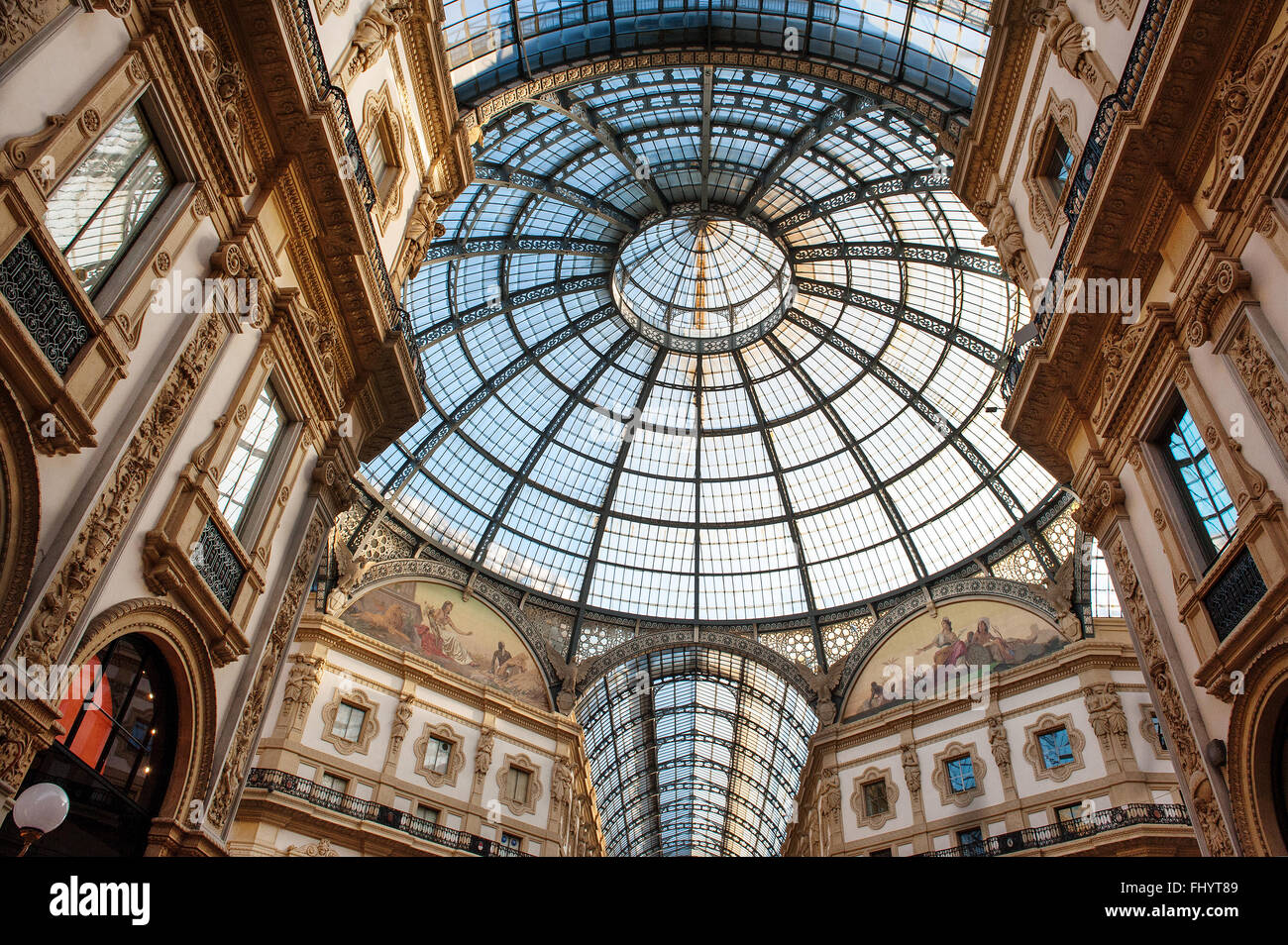 Low angle view toward circular domed ceiling and windows inside the Vittorio Emanuele Milan shopping mall interior - Stock Image