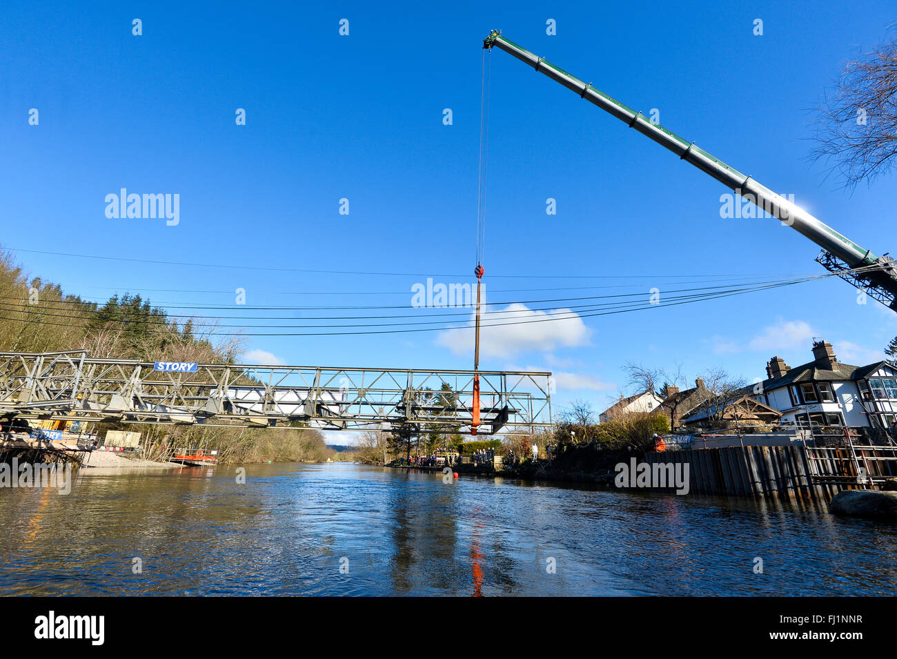 Ullswater, Cumbria, UK. 28th Feb, 2016. The temporary bridge is lifted into place across the River Eamont at Pooley - Stock Image