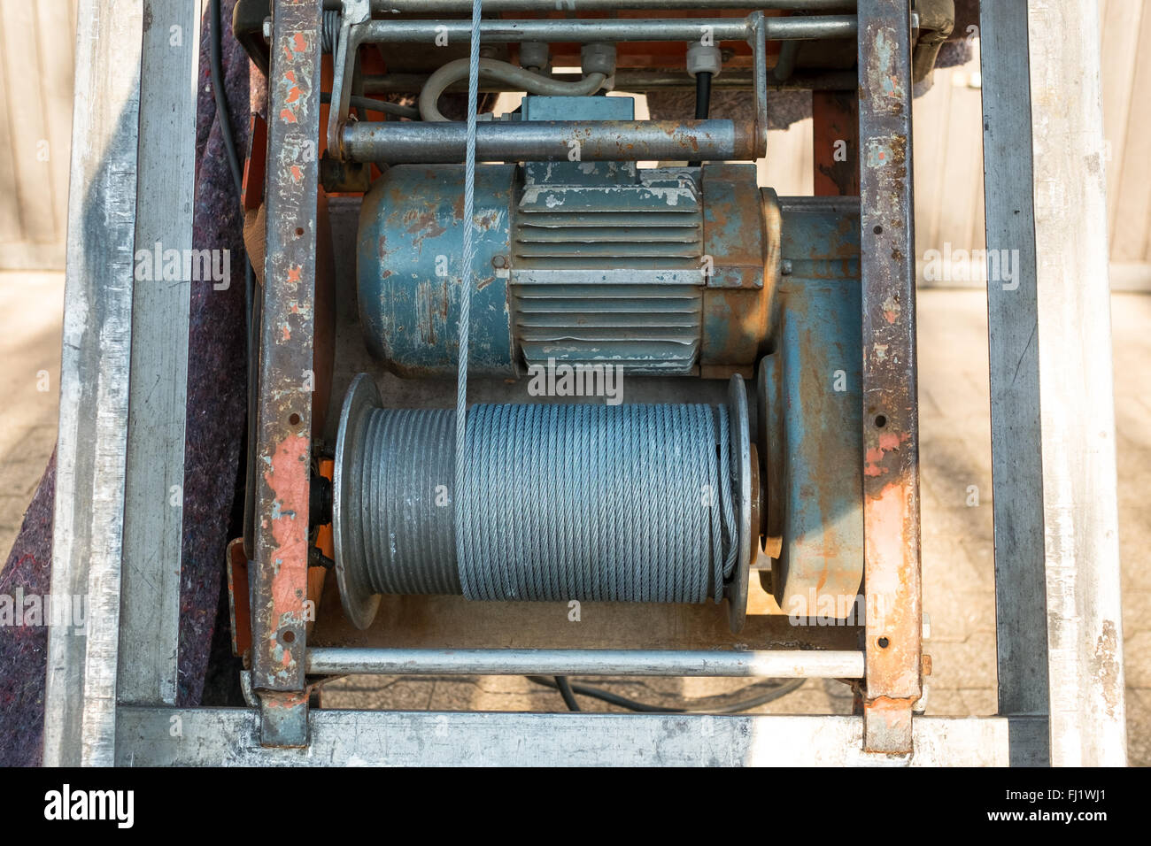 Electric cable winch with steel cable and electric motor Stock Photo ...