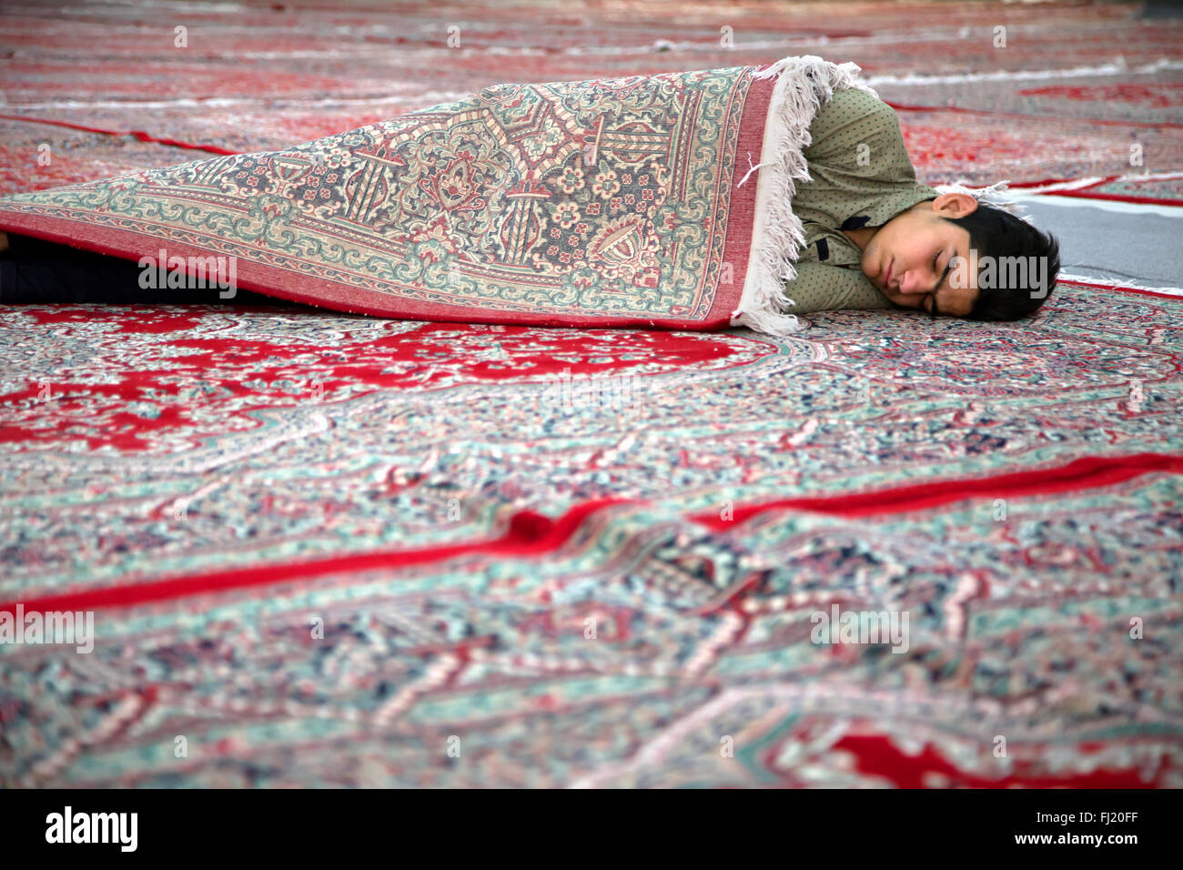 Man sleeping in Iran in the Mausoleum of Ayatollah Khomeini, south of Tehran - Stock Image