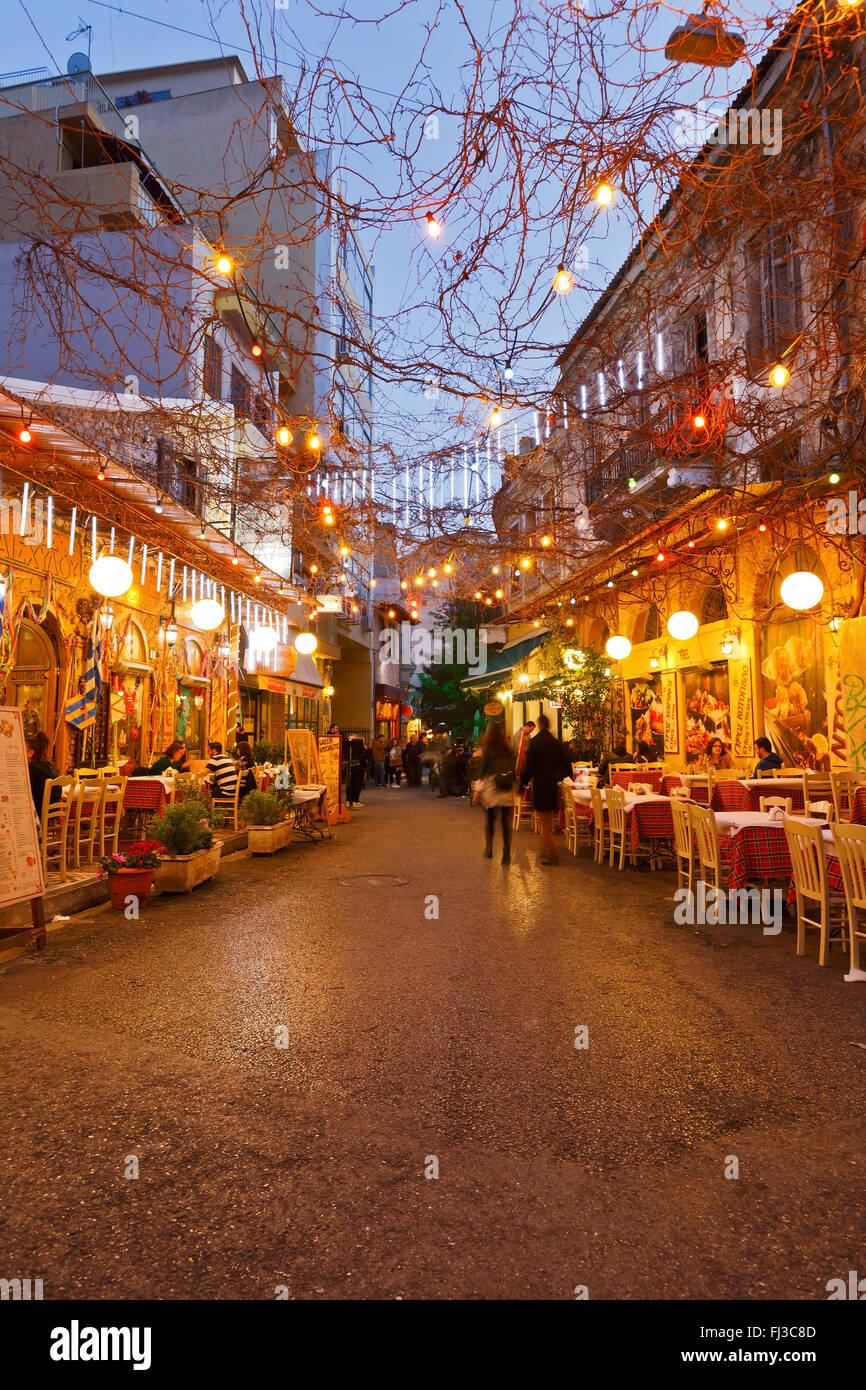 Restaurants and coffee shops in Psirri neighborhood near Heroes' square, Athens. - Stock Image