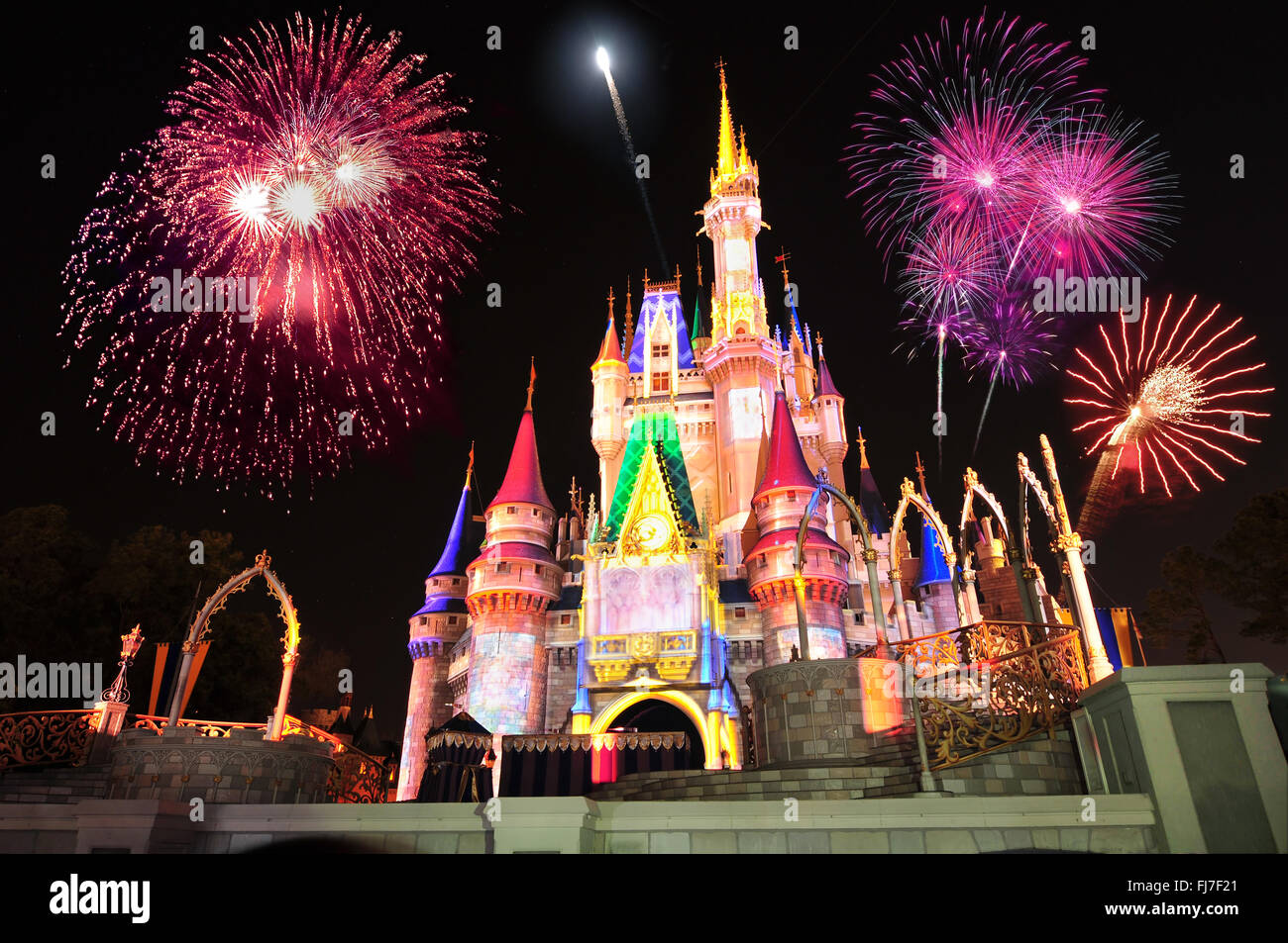 Display of fireworks and colorful lights on Cinderella's Castle in Magic Kingdom at DisneyWorld, Orlando, FloridaStock Photo