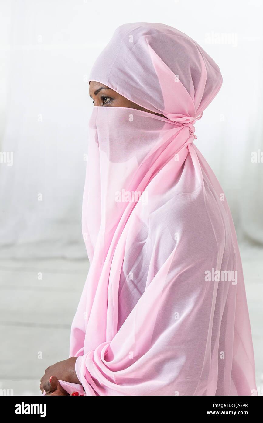 Beautiful  black african muslim woman wearing pink headscarf - Stock Image