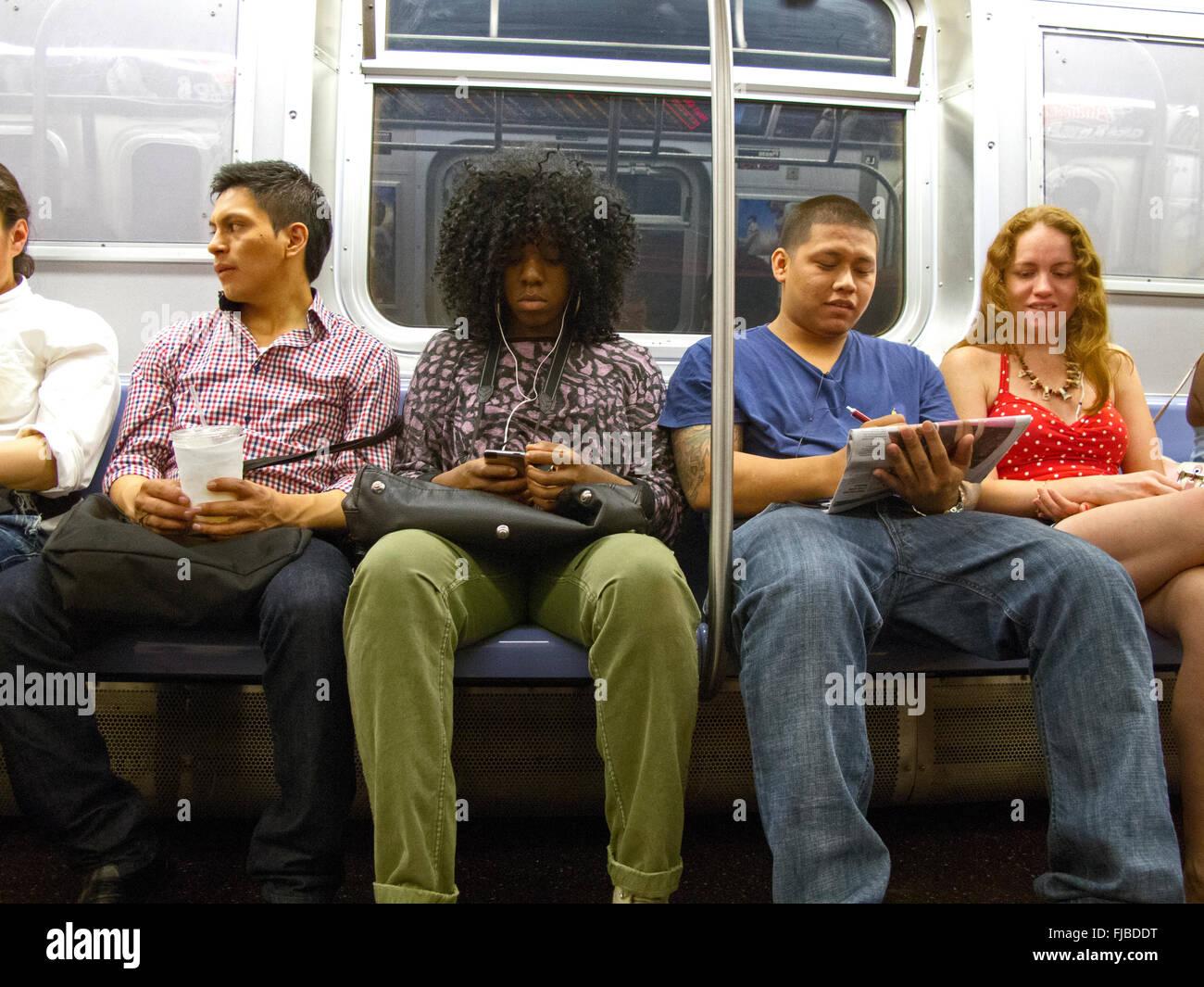 subway riders on train NYC - Stock Image